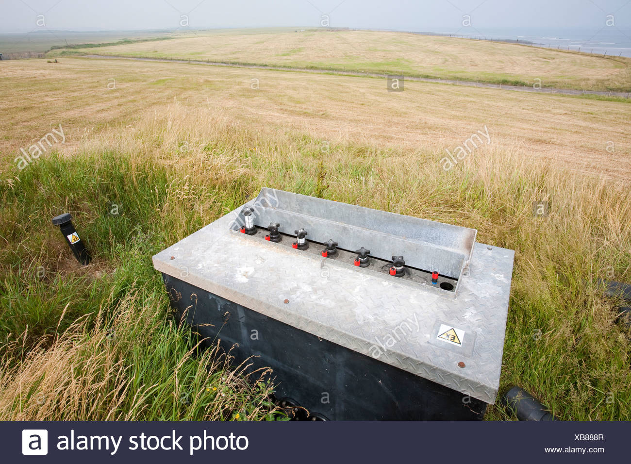 An old rubbish tip on Walney Island in Cumbria where the methane escaping from the decomposing rubbish is being captured - Stock Image