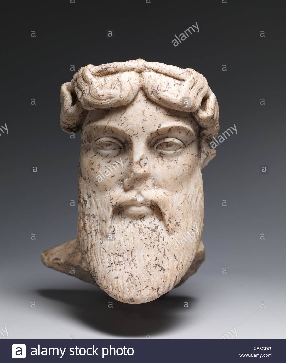 Marble head of a god, probably Dionysos. Period: Imperial; Date: 1st or 2nd century A.D; Culture: Roman; Medium: Marble; Dimensions: H. 16 3/8 in. - Stock Image