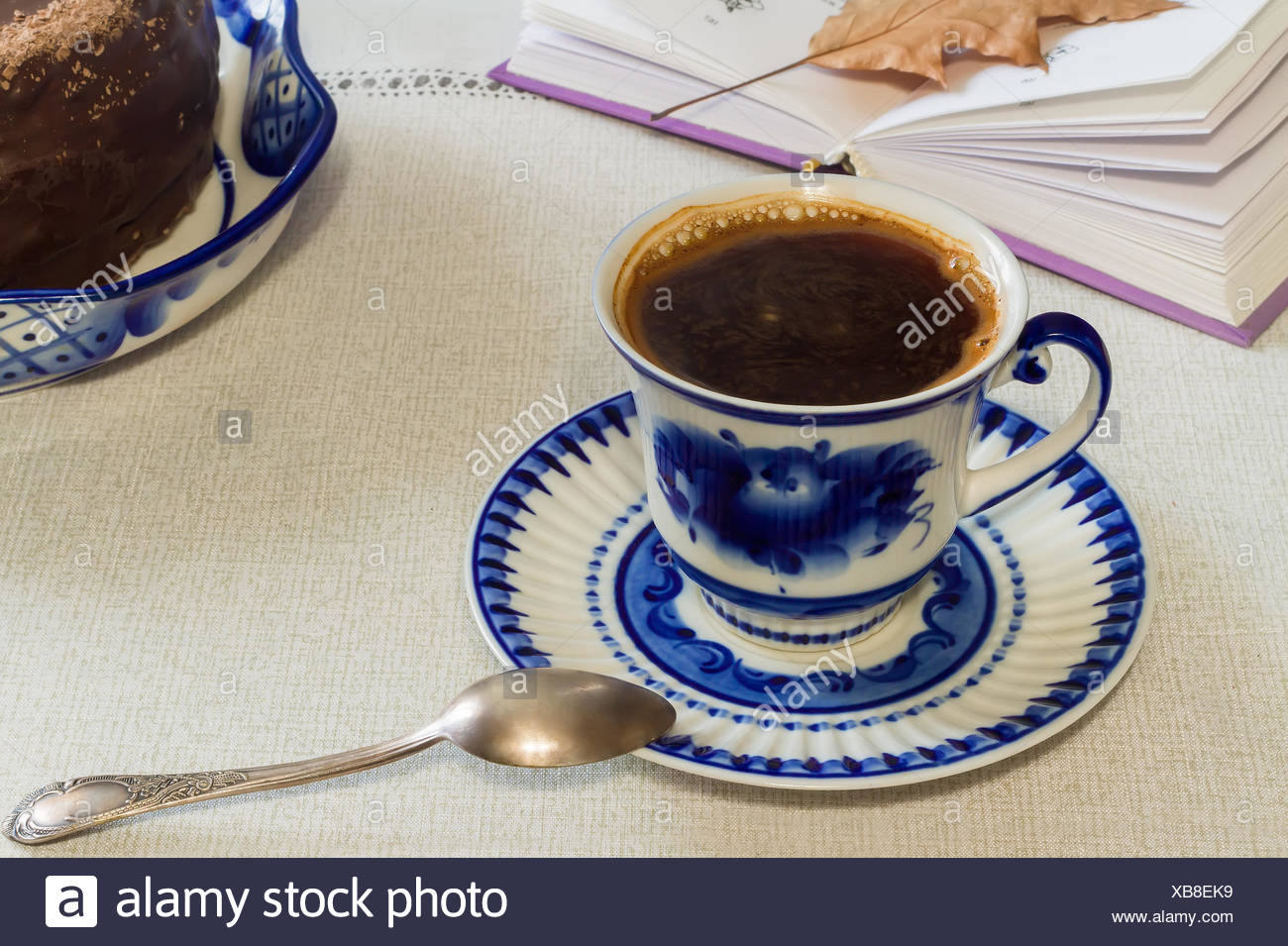 A Cup of black coffee and cake on the table. Stock Photo