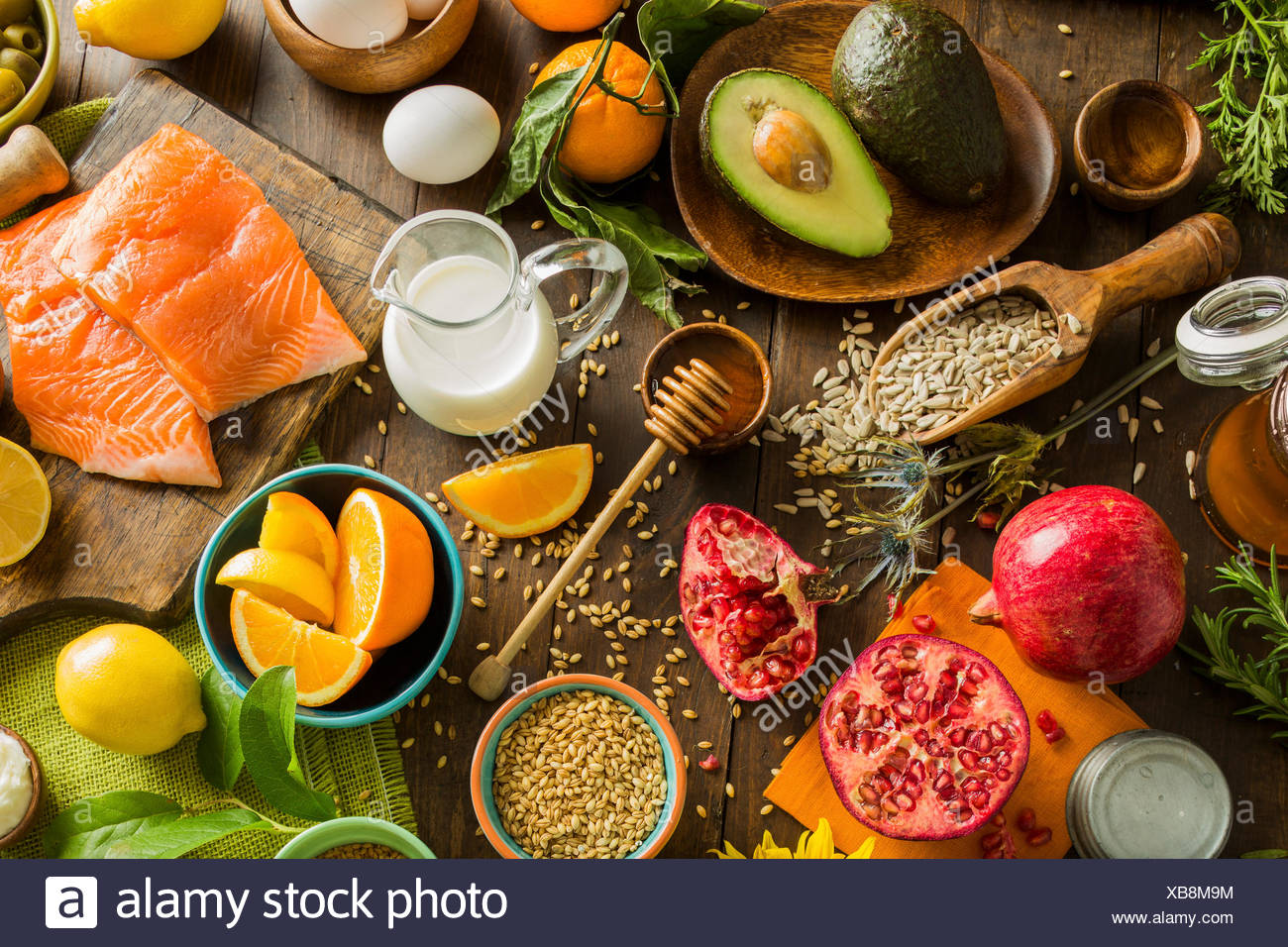 Overhead view of messy table with various fruits and seeds - Stock Image