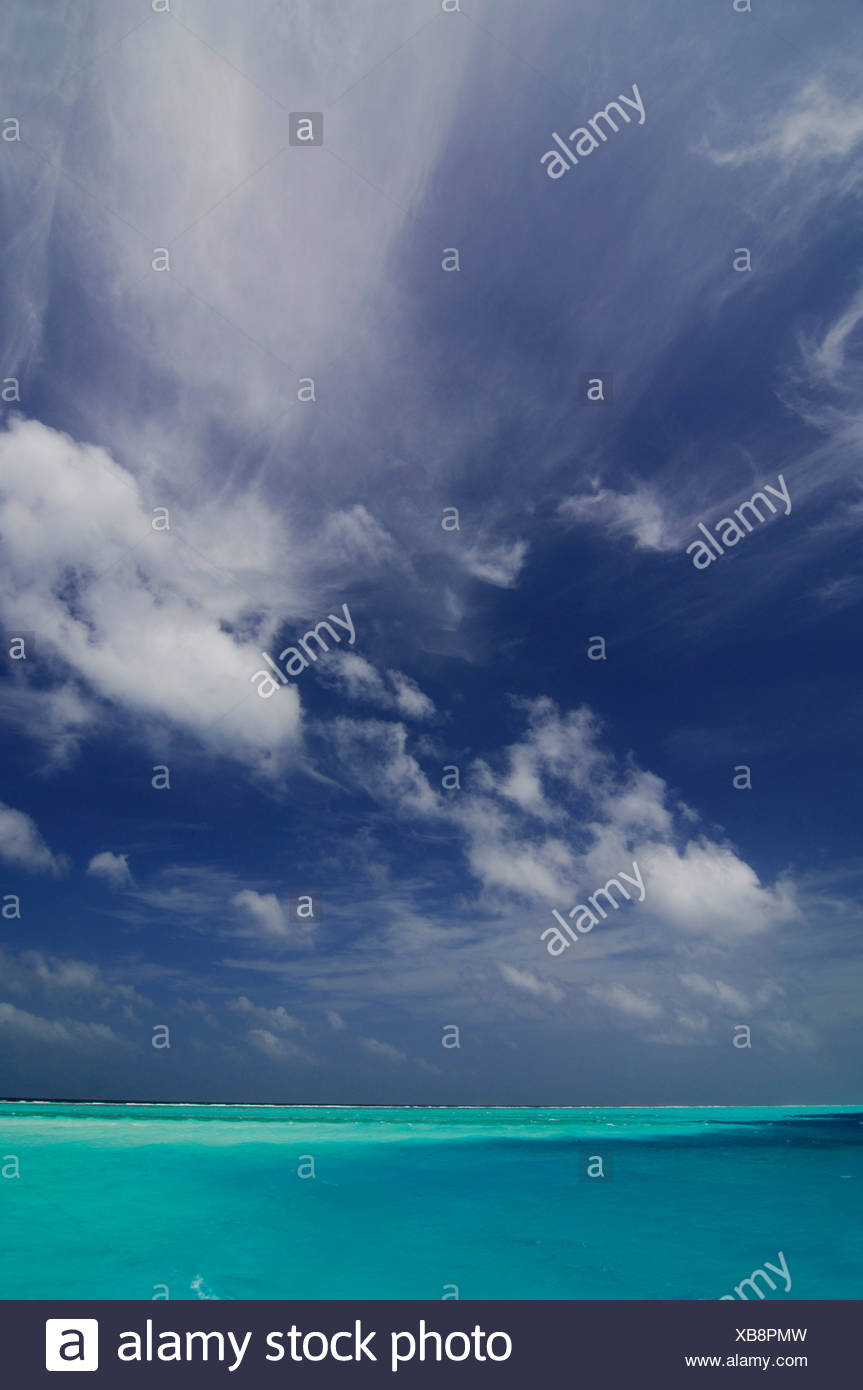 Atmospheric clouds and turquoise sea, Laguna Resort, The Maldives, Indian Ocea - Stock Image