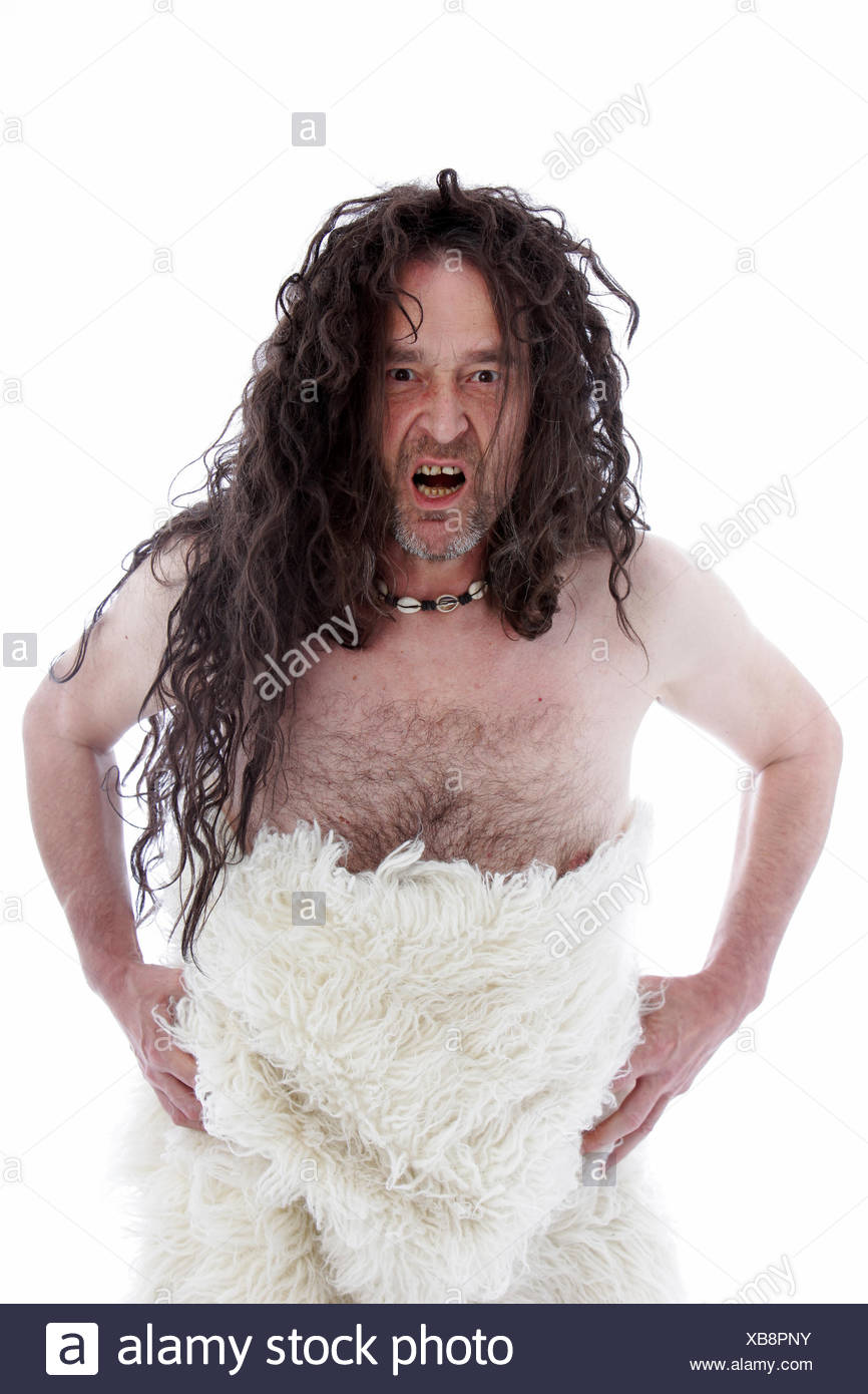 Snarling uncouth long haired caveman - Stock Image
