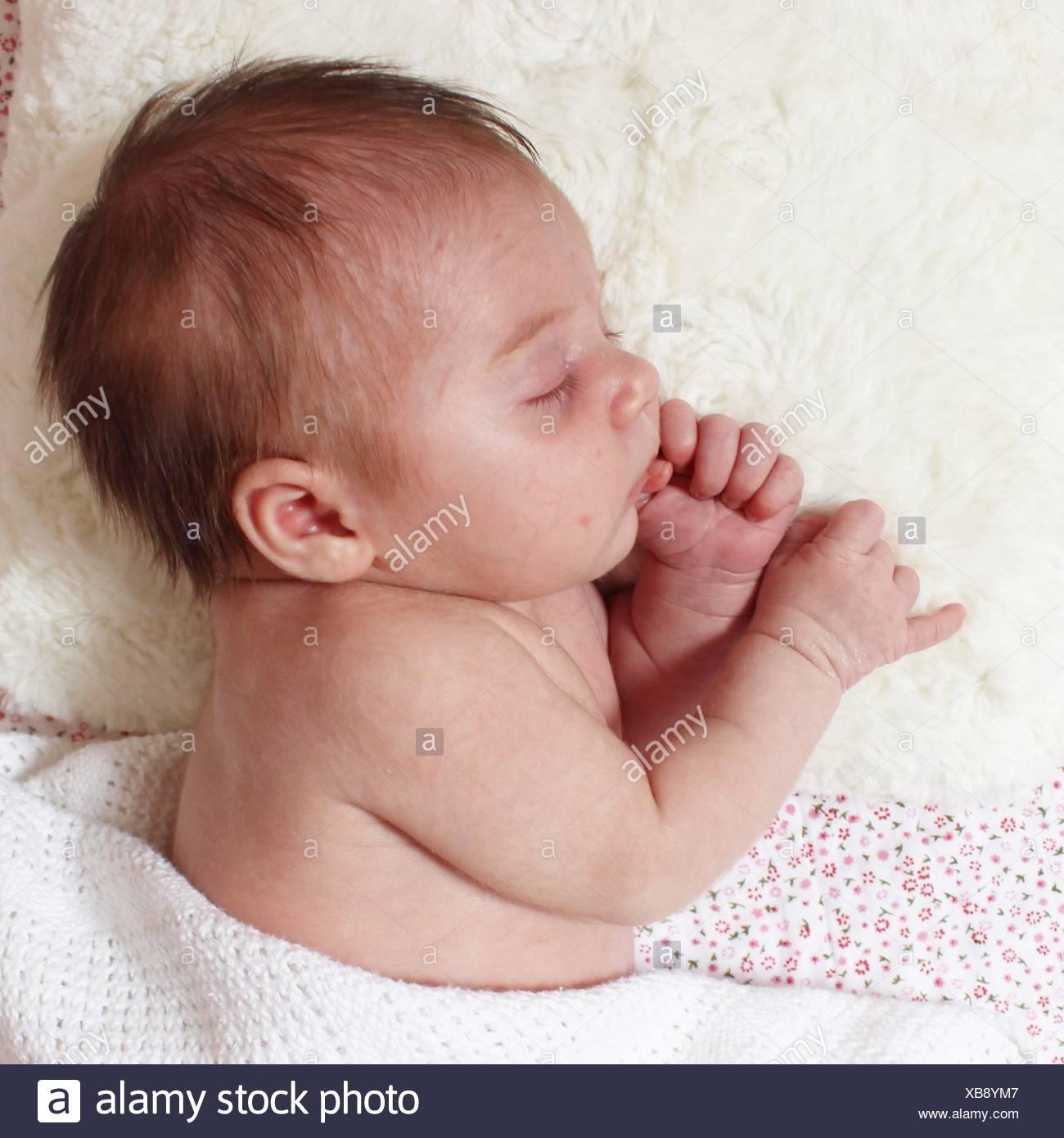 Baby girl sleeping - Stock Image