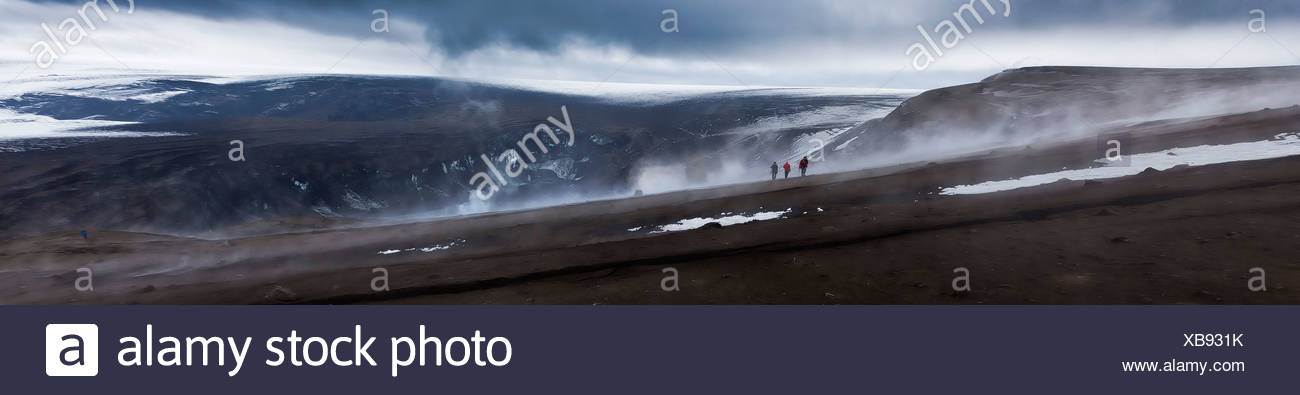 Scientist viewing steaming crater after Grimsvotn eruption, Iceland Stock Photo