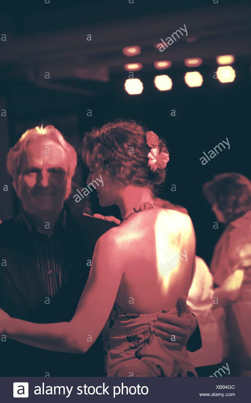 18-20 years, 50-60 years, father, daughter, dancing - Stock Image