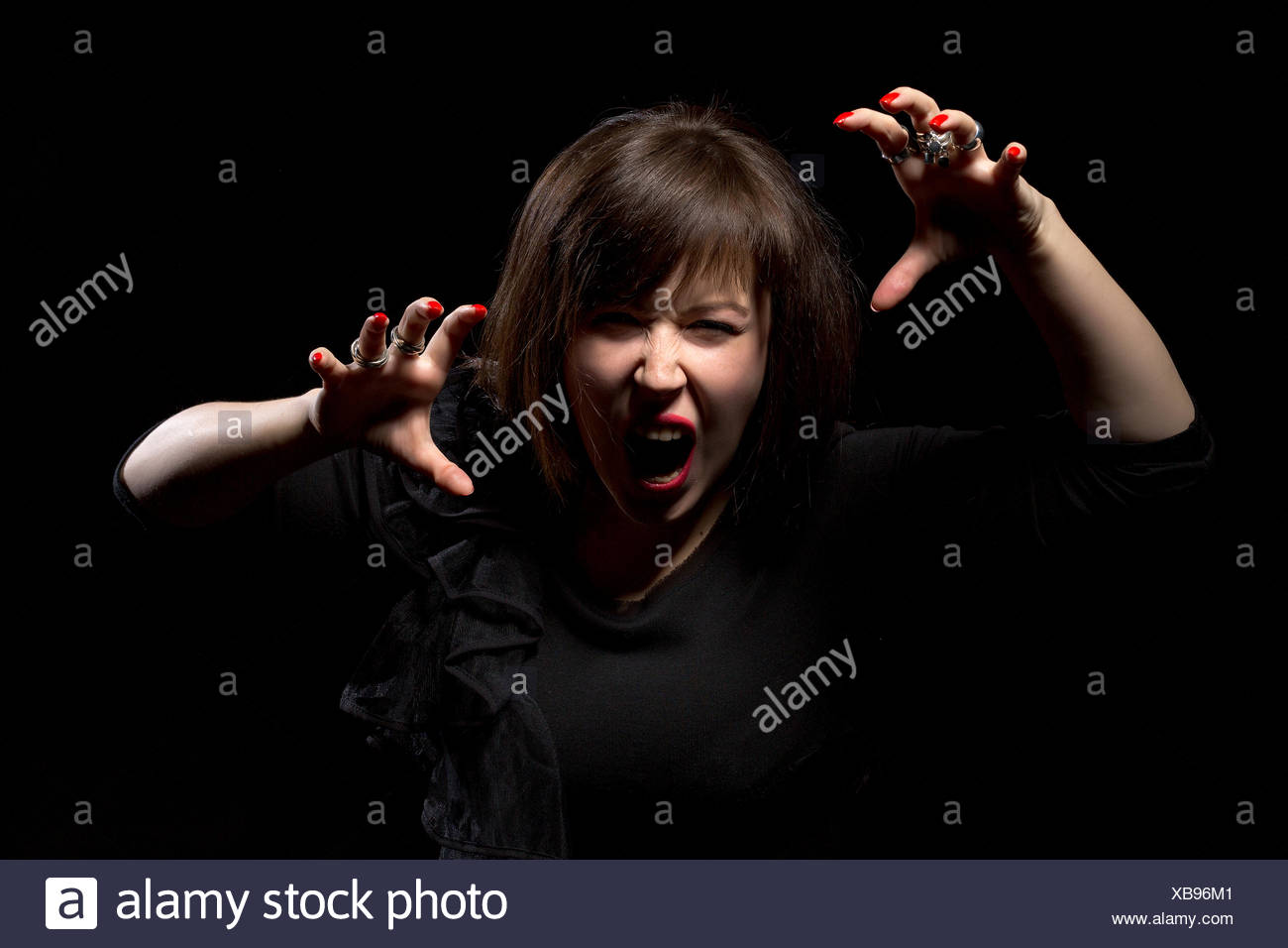 Woman throwing a temper tantrum - Stock Image