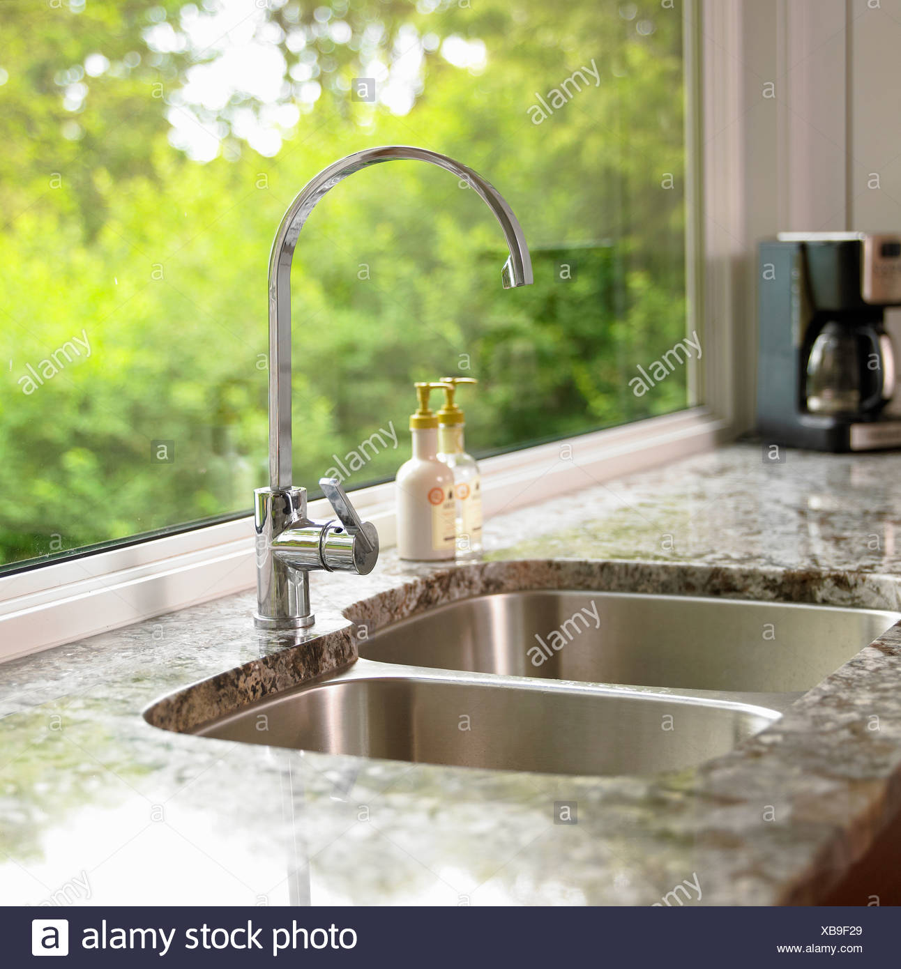 Detail of kitchen sink with granite countertop victoria vancouver island british columbia canada