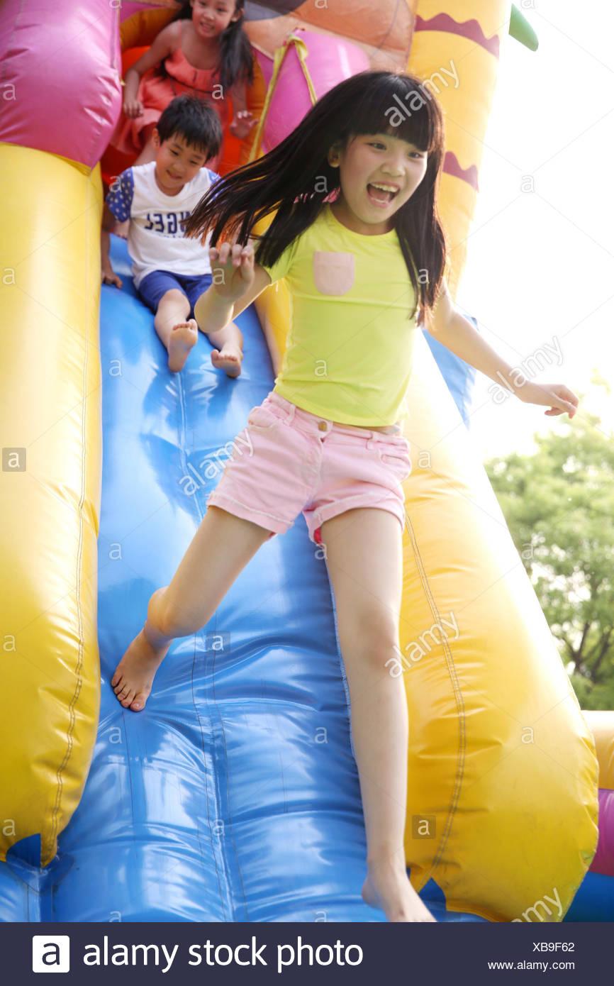 Children at amusement park - Stock Image