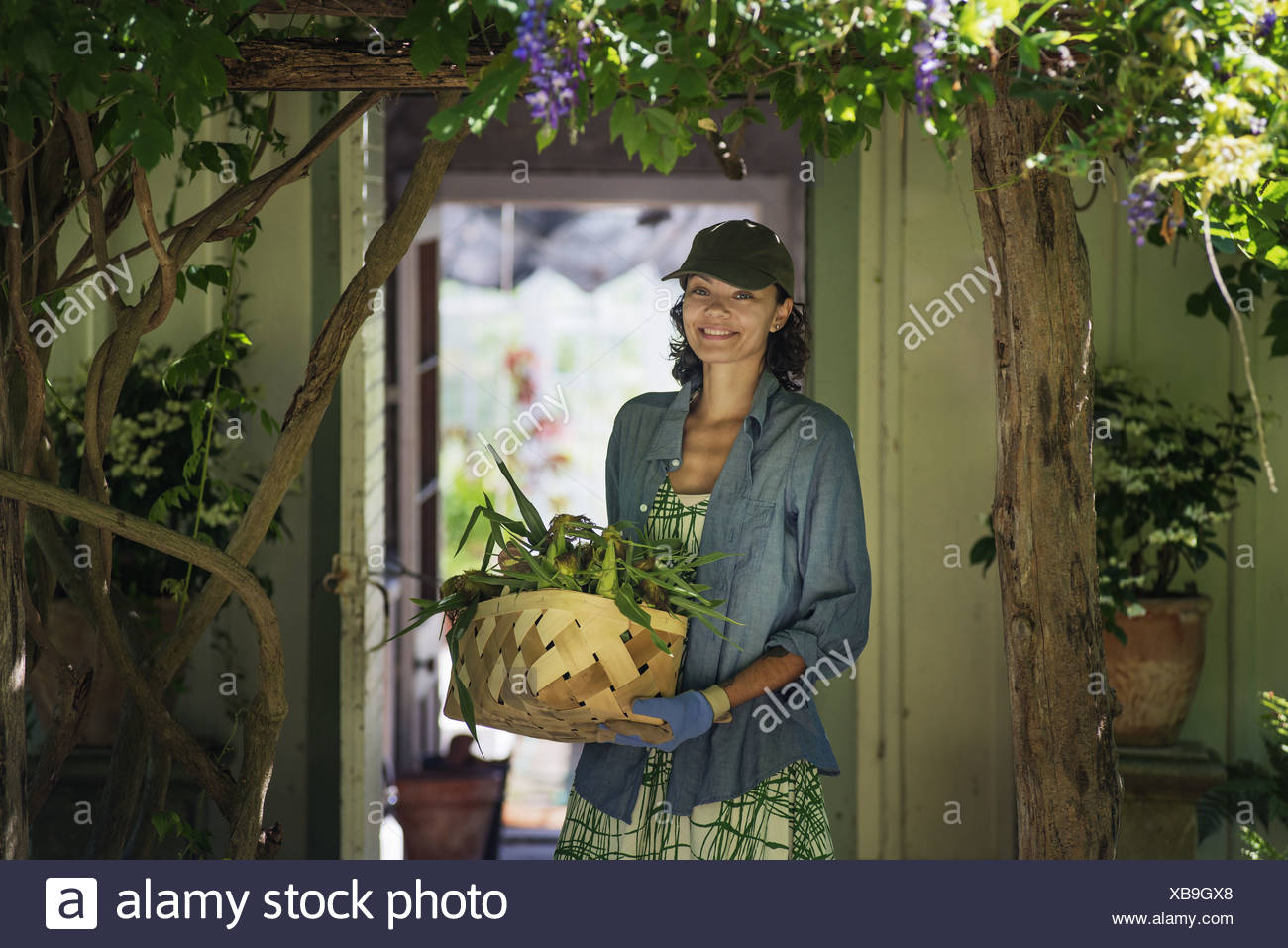 New York state USA young woman in farmhouse kitchen with large window - Stock Image