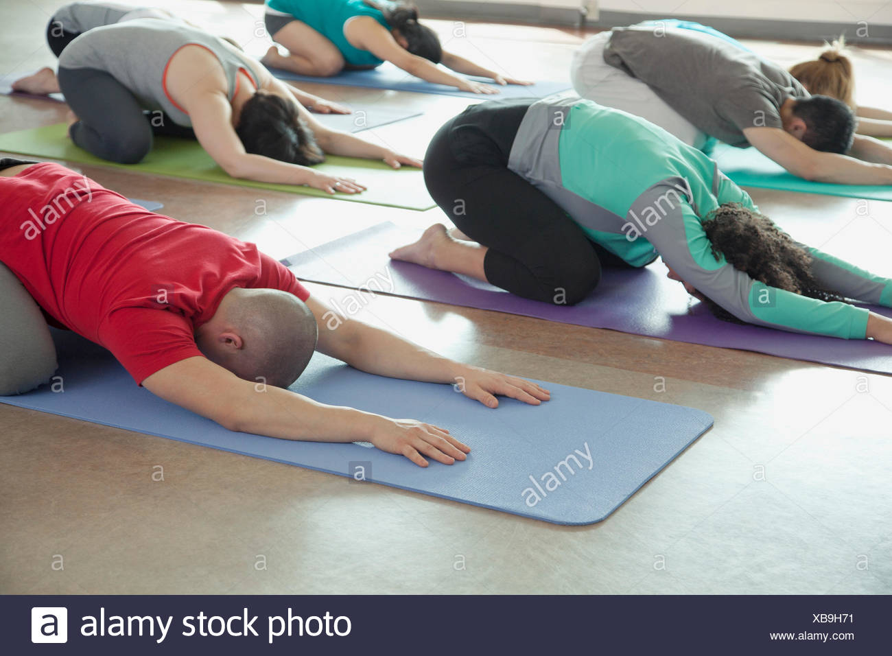 yoga class in child pose - Stock Image