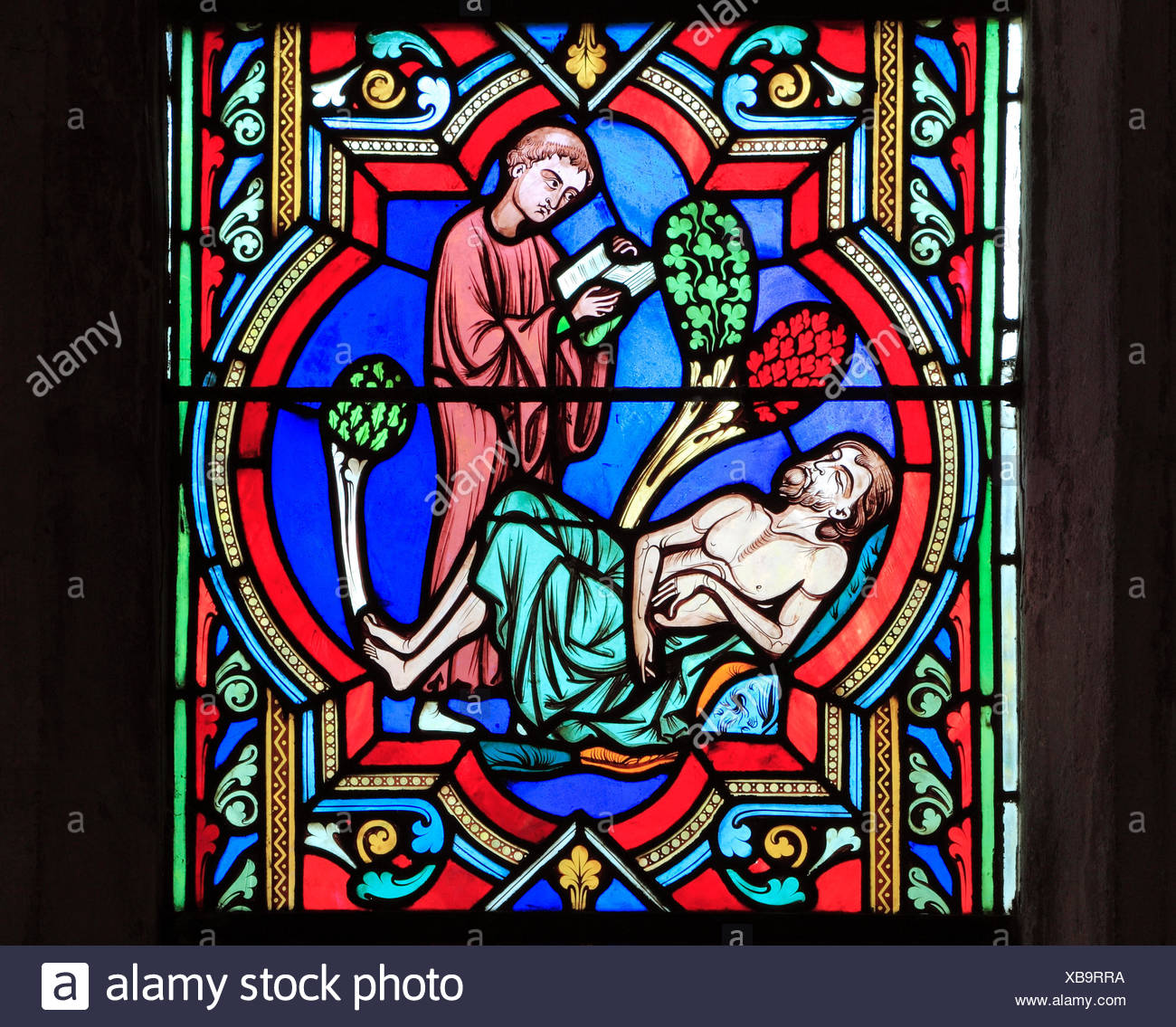 The Good Samaritan Parable, a Levite 'passes by on the other side', ignoring dying traveller, by Oudinot of Paris, 1859, Feltwell, Norfolk, England, U - Stock Image
