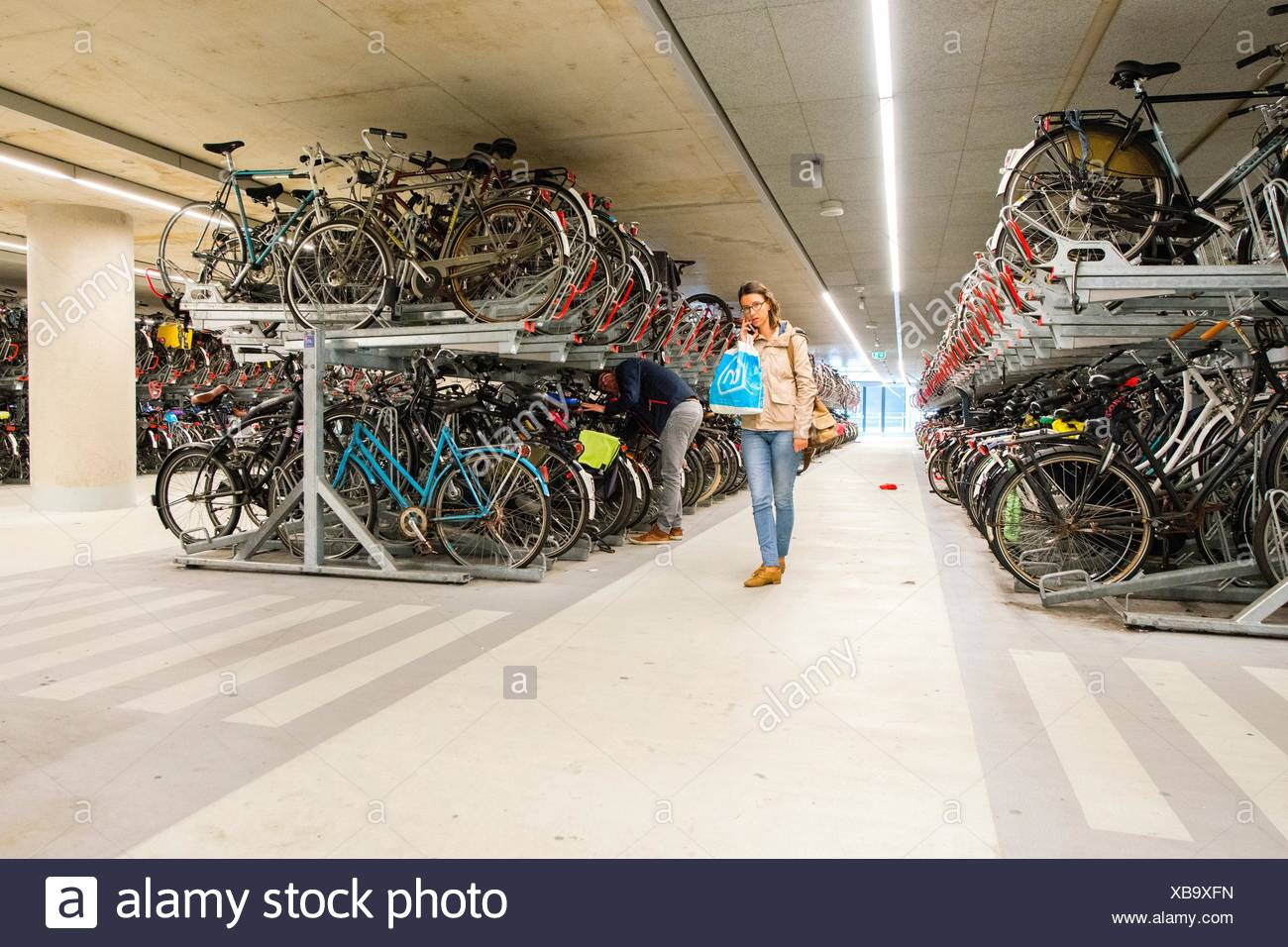 Young Man And Woman Parking His Bike At The Newly (2016