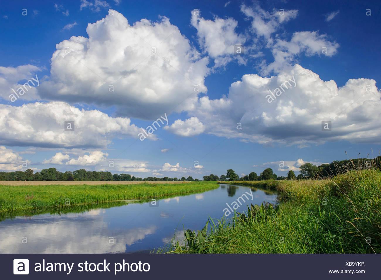 clouds over river Hunte in summer, Goldenstedt highmoor, Germany, Lower Saxony, Oldenburger Muensterland - Stock Image