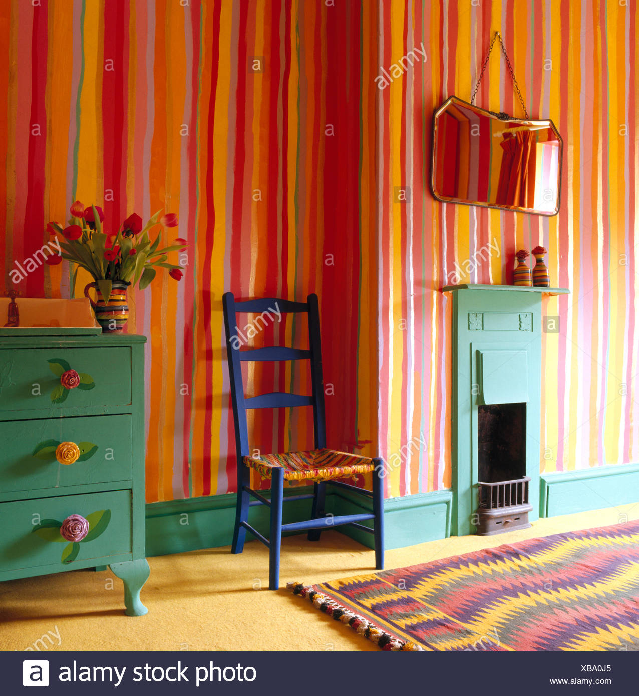brightly painted furniture. colorful stripes painted on walls of eighties bedroom designed by mary-rose young with brightly furniture