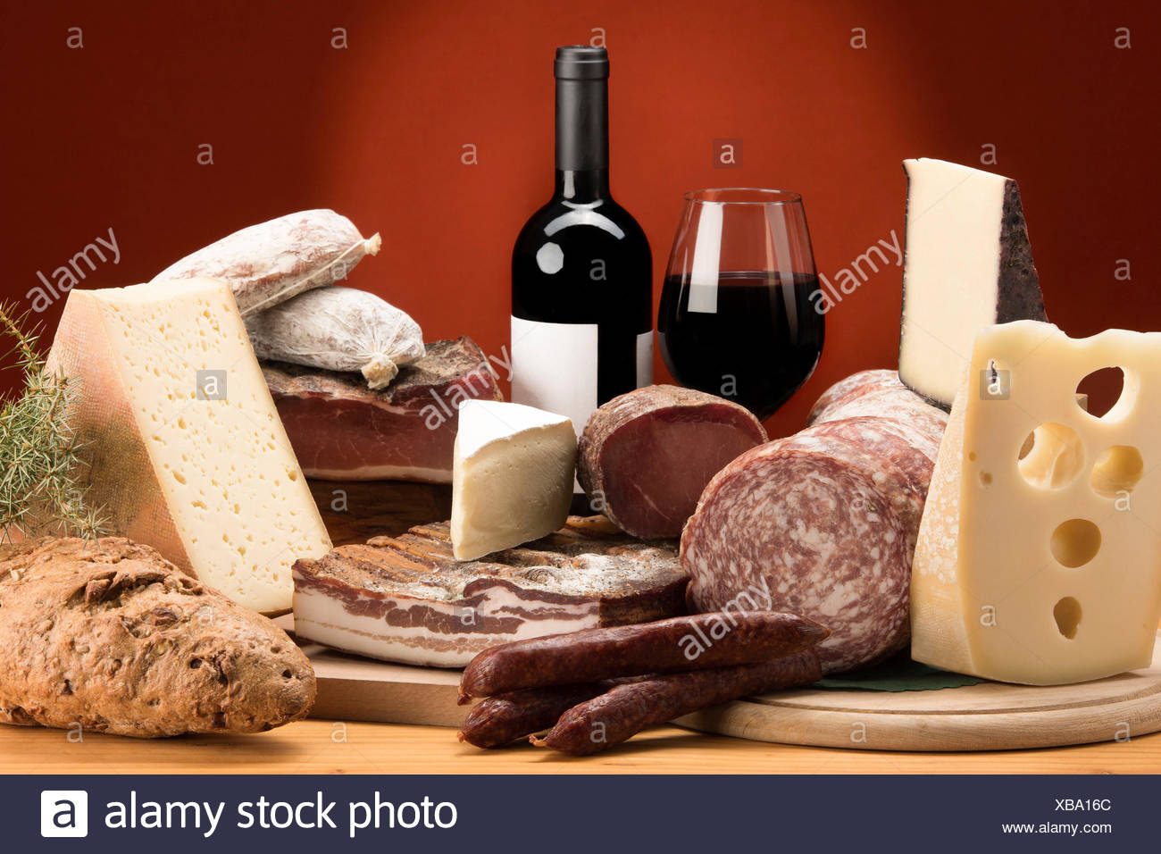 Still life, mixed salami, Mixed cheeses, typical products, red wine, Salami and cheeses, Trentino, AltoAdige, Dolomites, food, Stock Photo