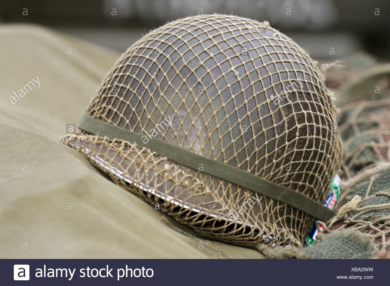 an  old us army helmet - Stock Image