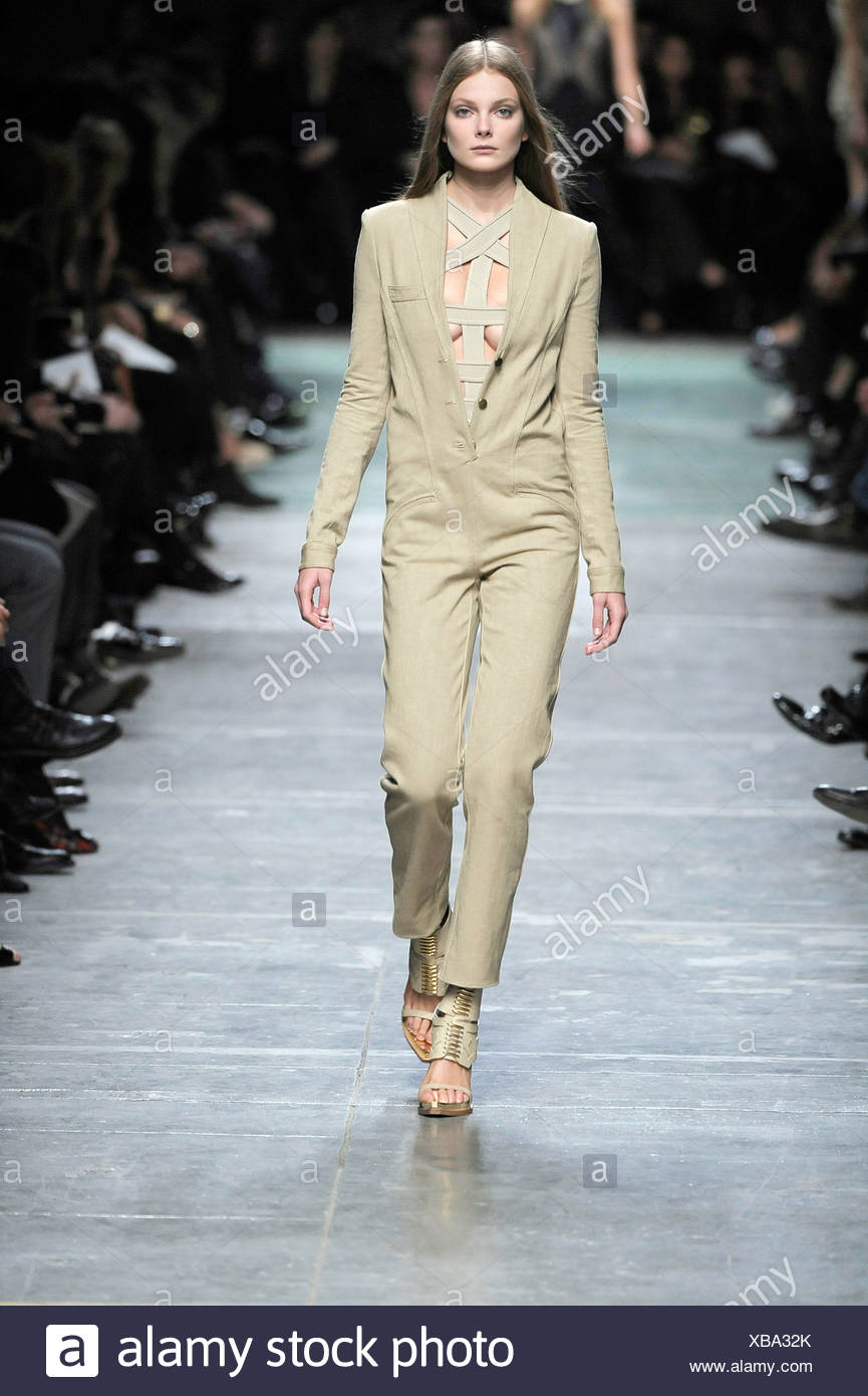 92522a70425a Givenchy Paris Ready to Wear Spring Summer Model wearing a khaki beige  jumpsuit a revealing bandage style top and matching cut
