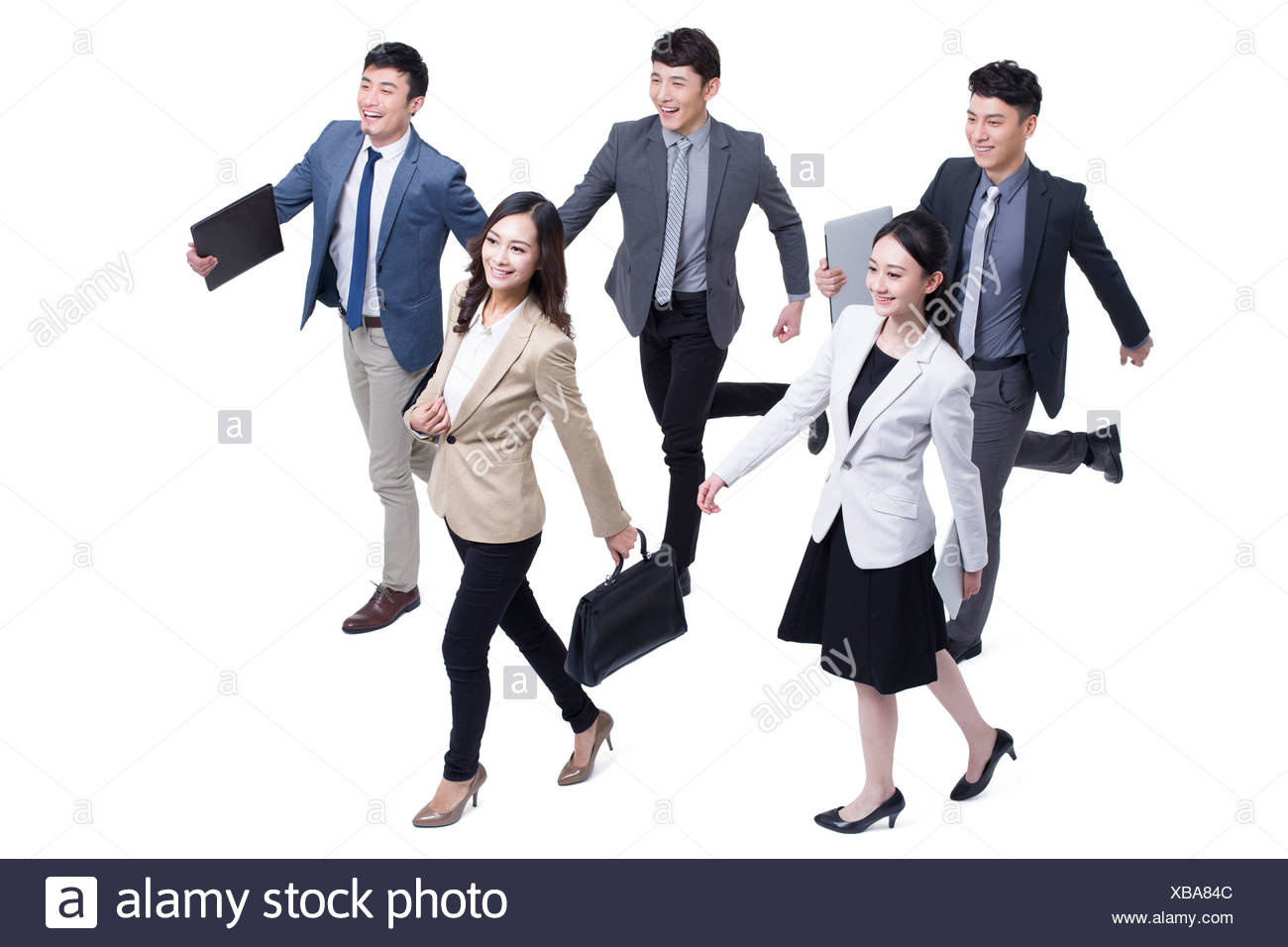 Business people walking forward confidently - Stock Image
