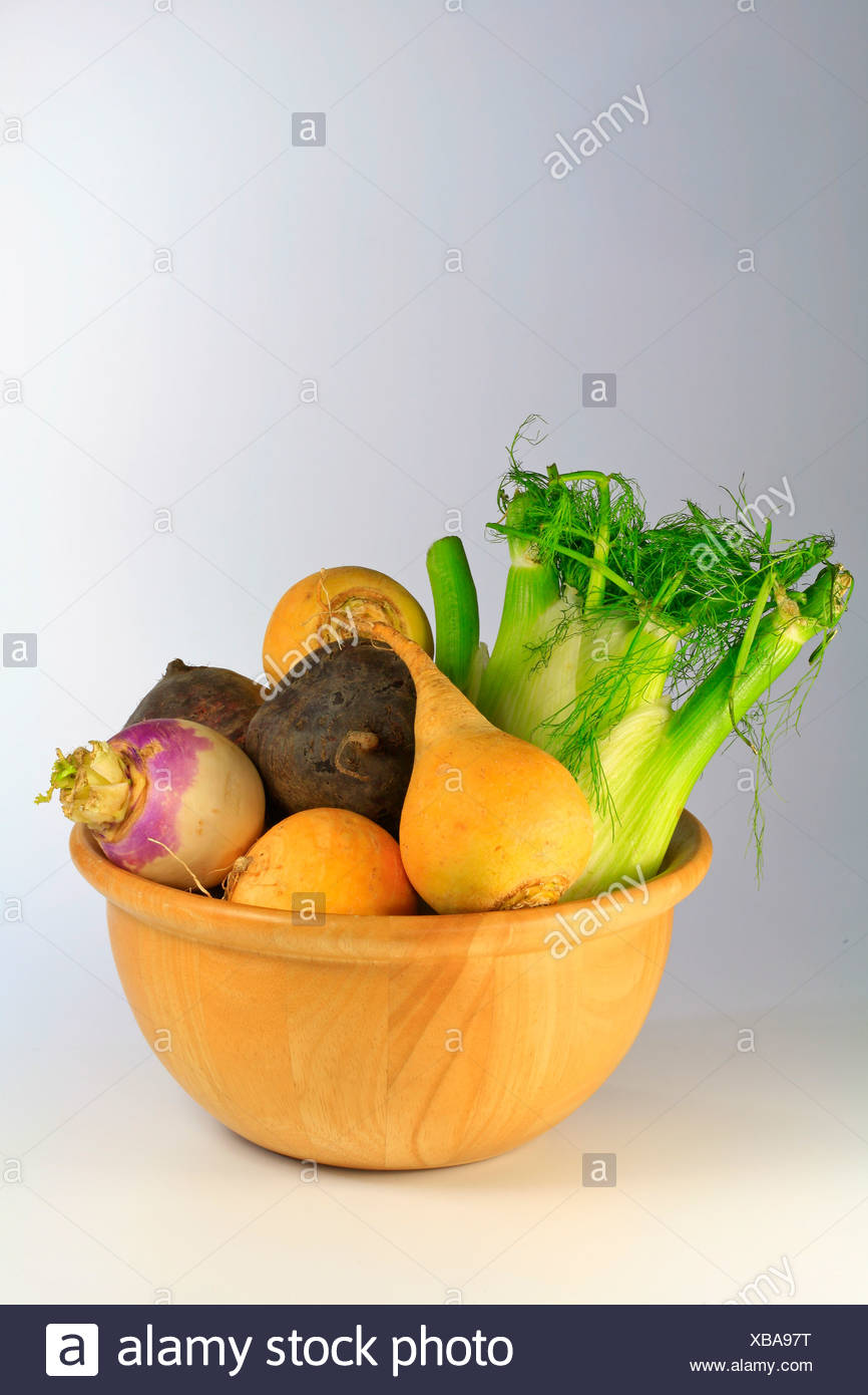 Vegetables in a wooden bowl, swedes or yellow turnips, turnips, beetroot and celery Stock Photo