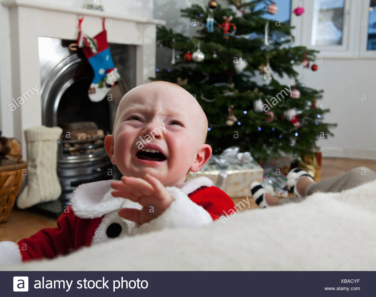 A baby crying at Christmas - Stock Image