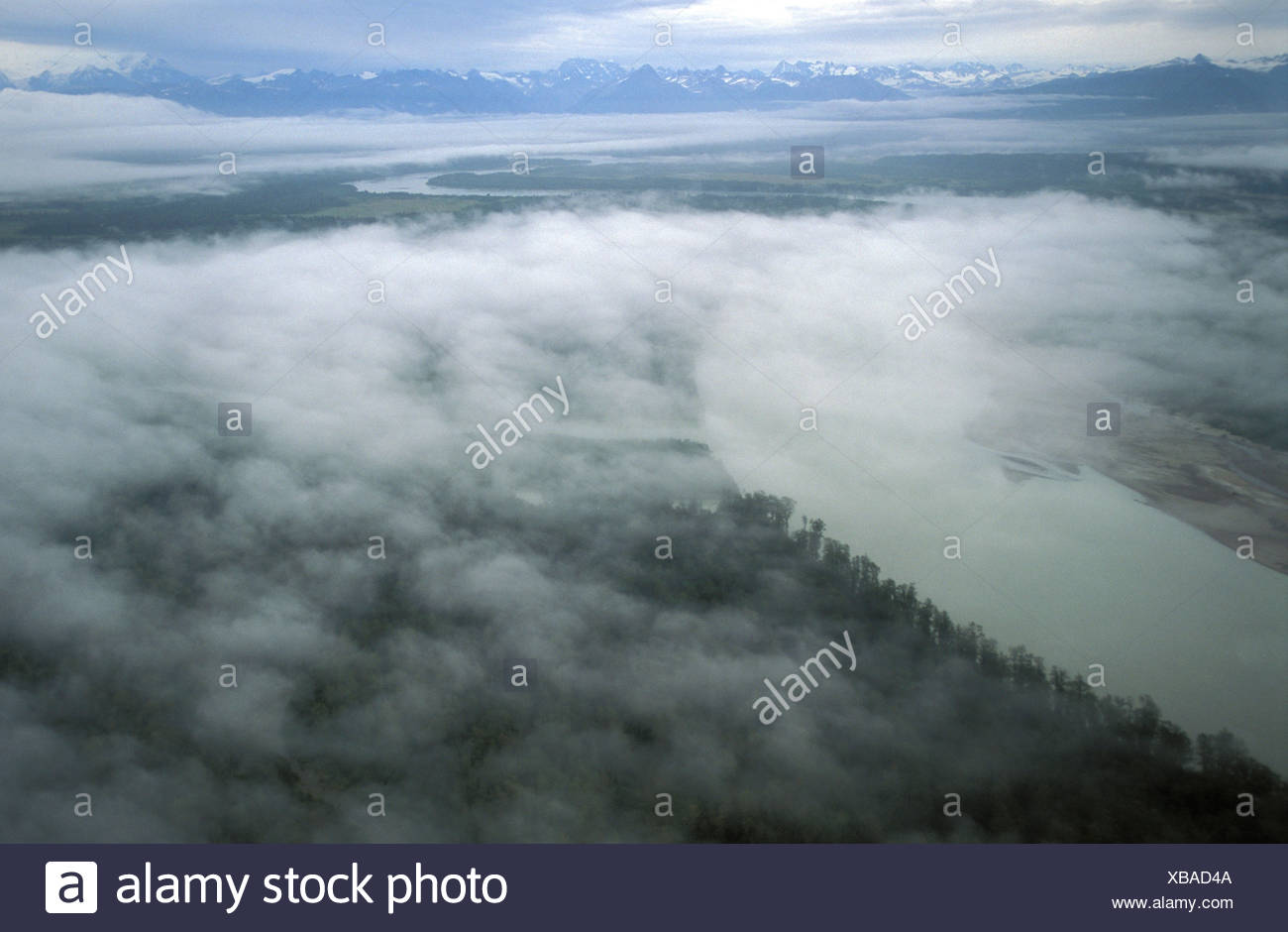 Coastal Plain, Cook Inlet, Chigmit Mountains, Aleutian Range, Alaska, USA, fog, clouds, above clouds, lush forest, stormy, view, - Stock Image