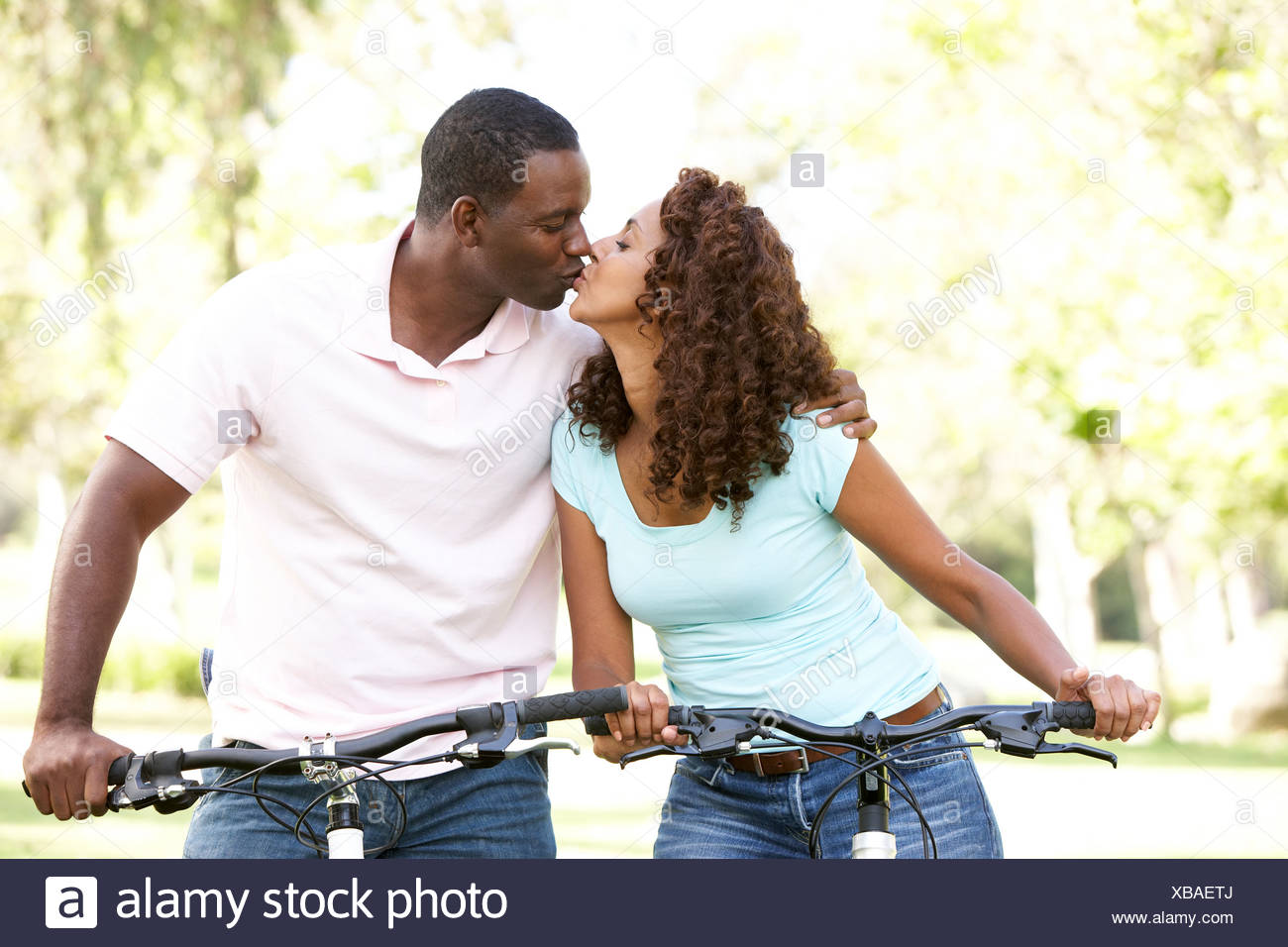 Couple On Cycle Ride in Park - Stock Image