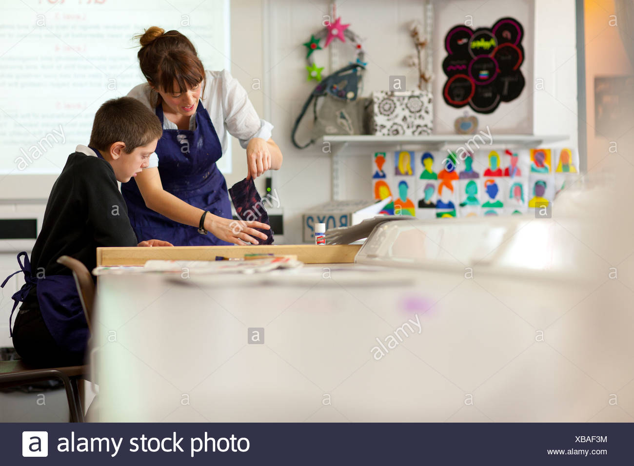 Teacher and student in school workshop - Stock Image