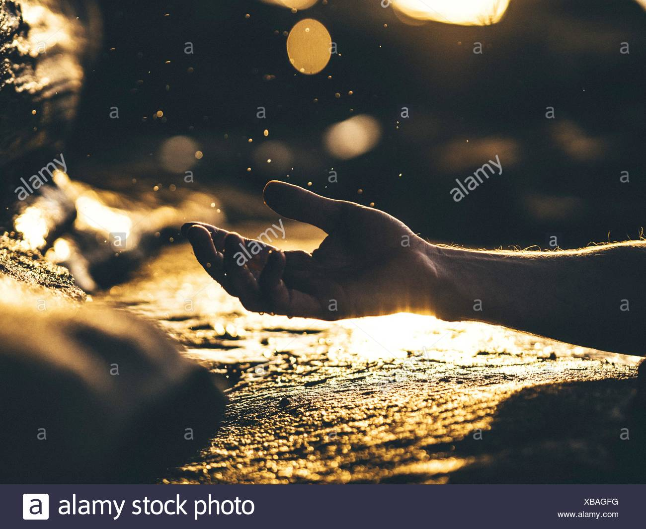 Human Hand In Gesture, Reflecting Surface - Stock Image