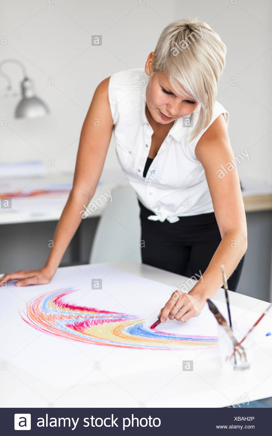 Female artist drawing - Stock Image
