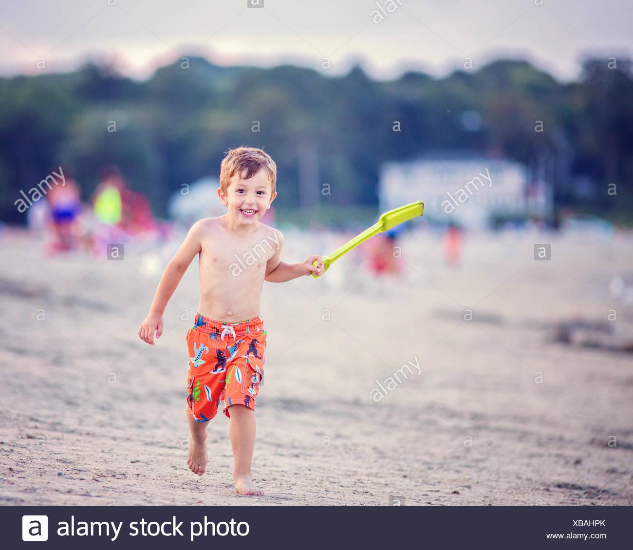 Boy playing on the beach, Good Harbor Beach, Massachusetts, USA - Stock Image