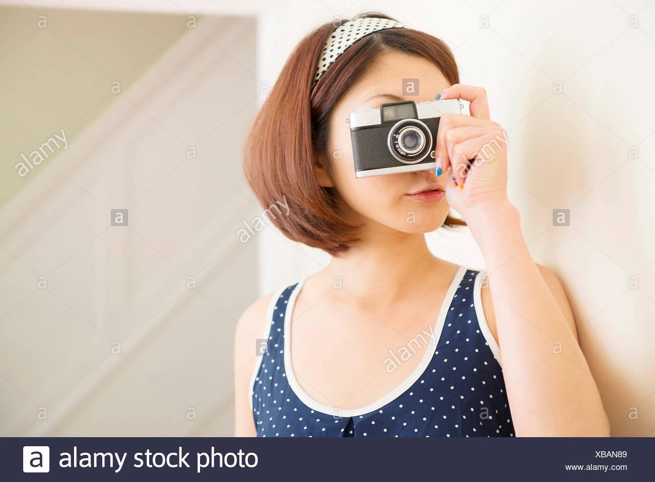 Woman taking photograph - Stock Image