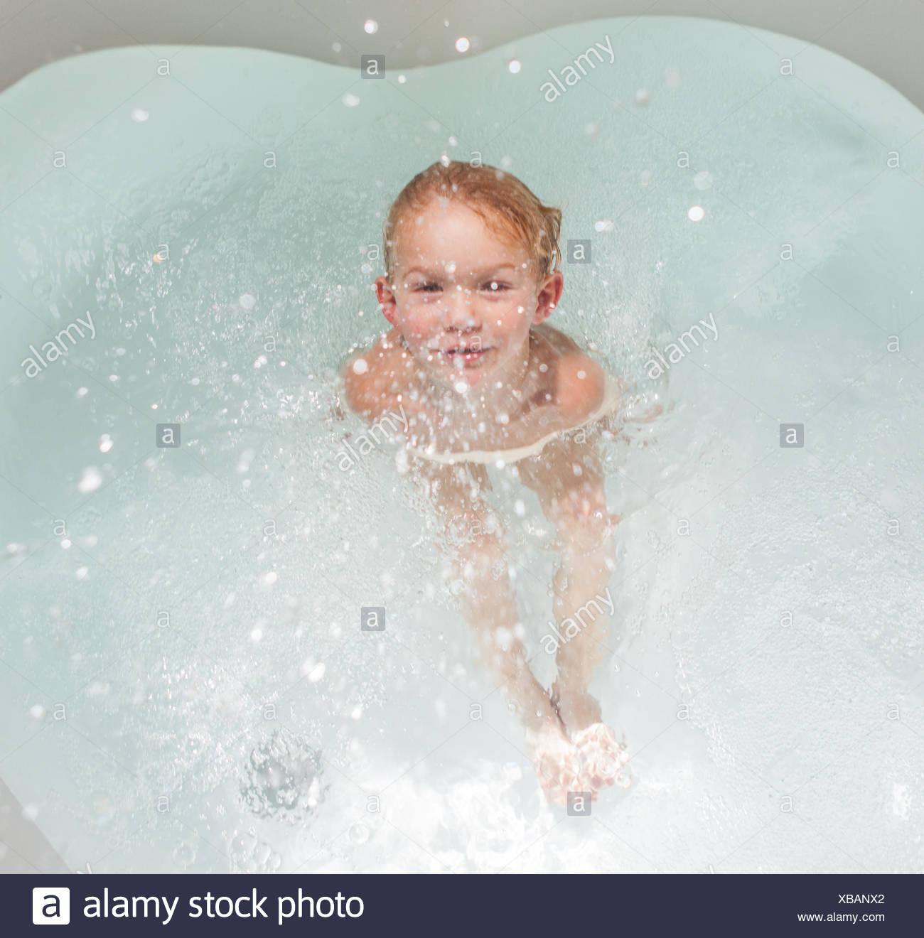 Toddler Splashing In Tub Stock Photos & Toddler Splashing In Tub ...