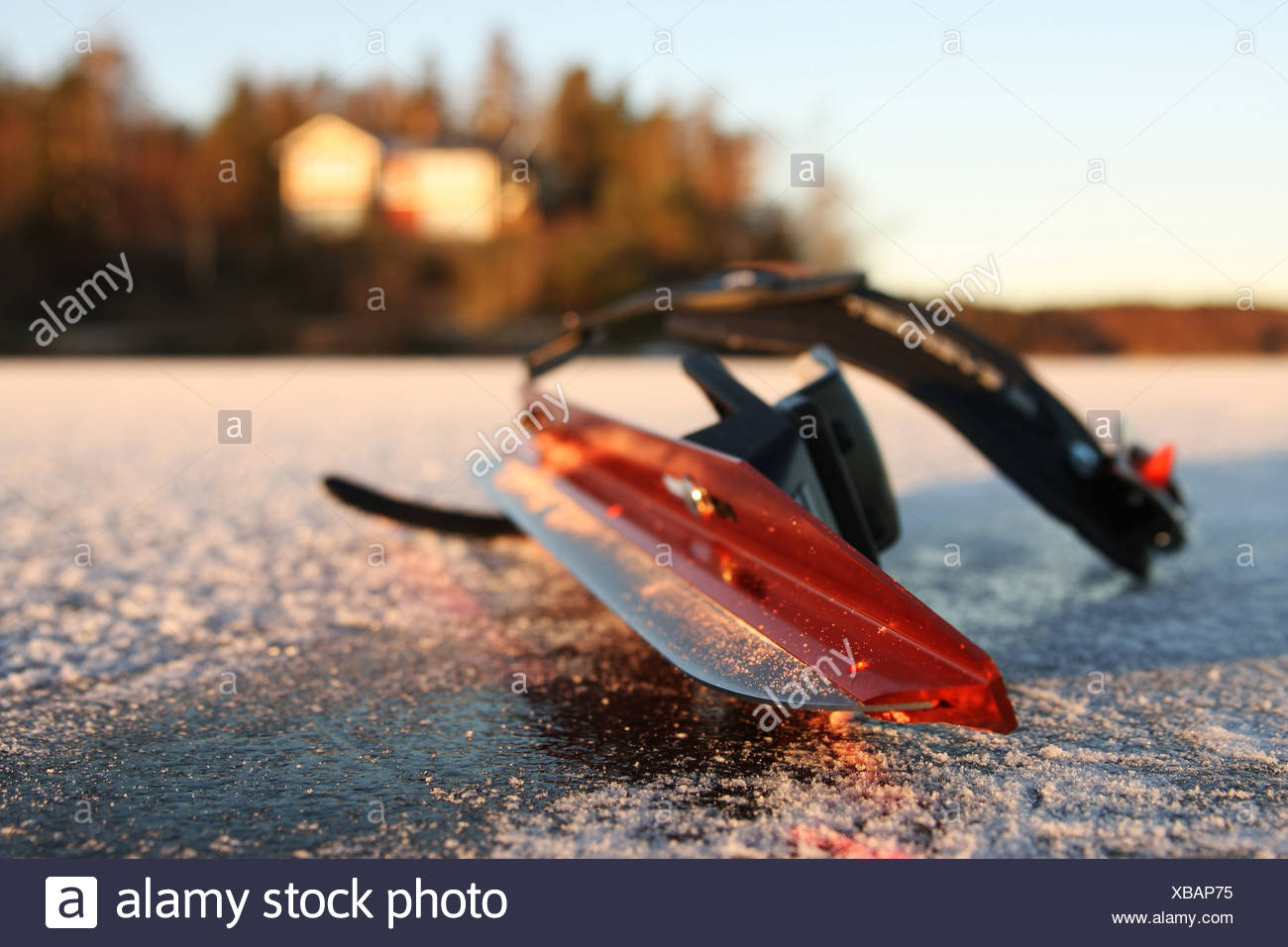 Close-up of an ice skate equipment on the frozen lake - Stock Image