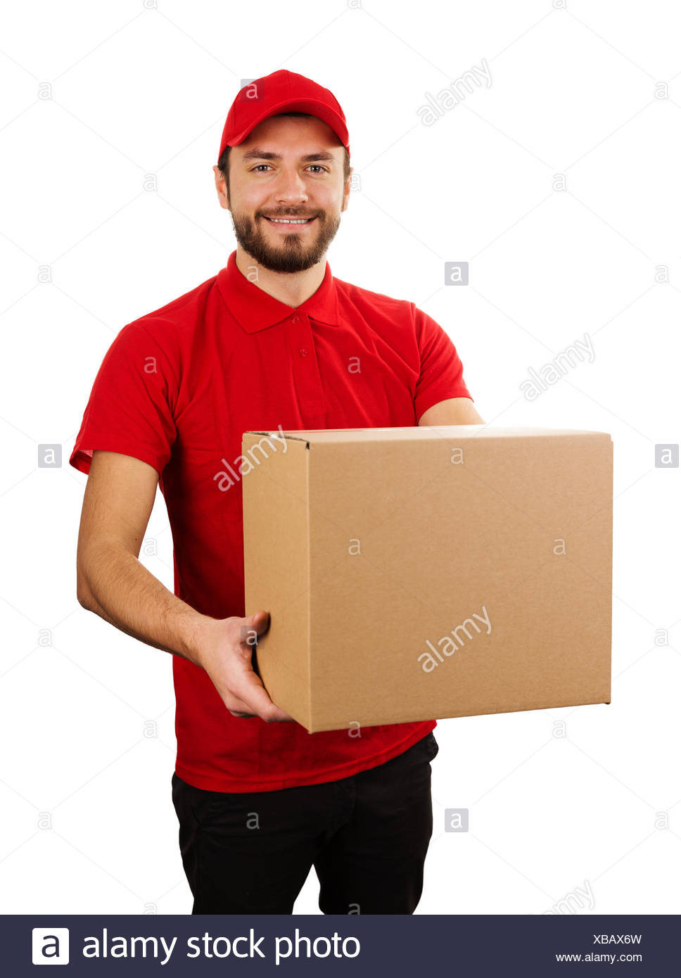 delivery service - young smiling courier holding cardboard box - Stock Image