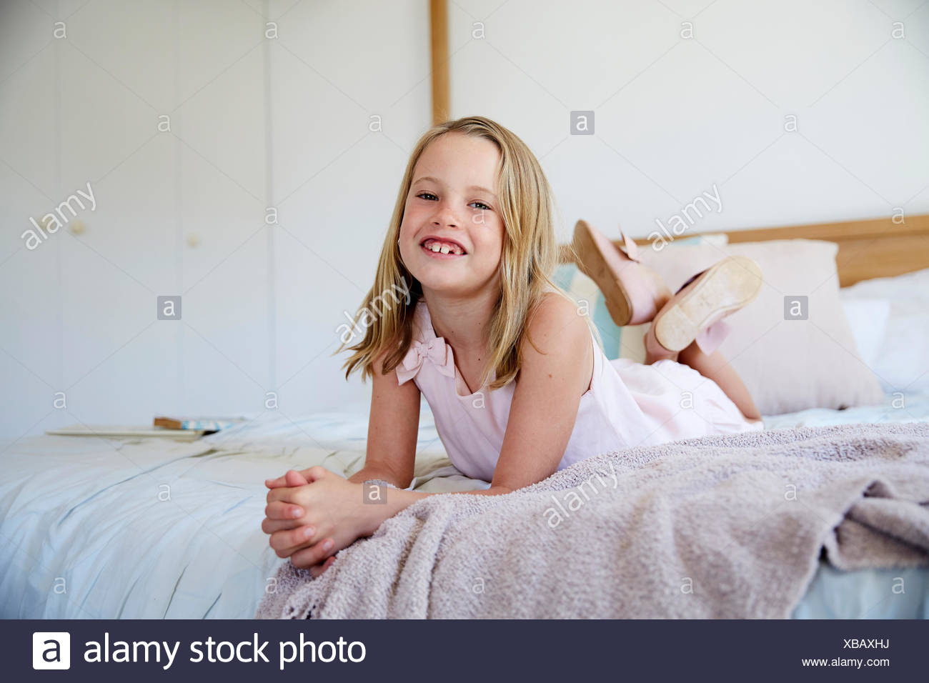 Awesome Portrait Of Smiling Little Girl With Tooth Gap Lying On Bed Interior Design Ideas Clesiryabchikinfo