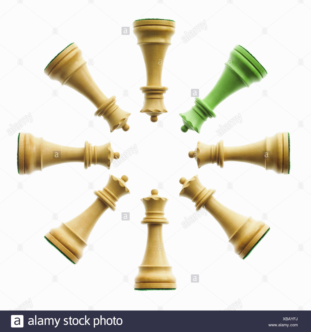 arrangement of pawn chess pieces green and brown - Stock Image