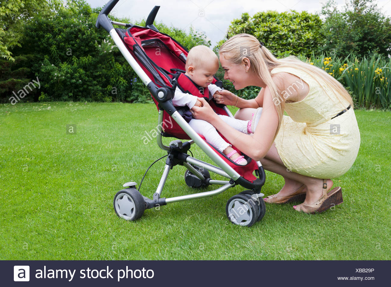 Netherlands, Helvoirt, Mother and daughter together outdoor - Stock Image