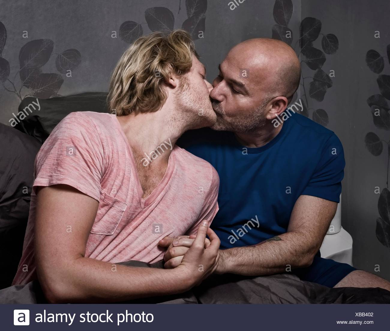 Mature gay men kissing