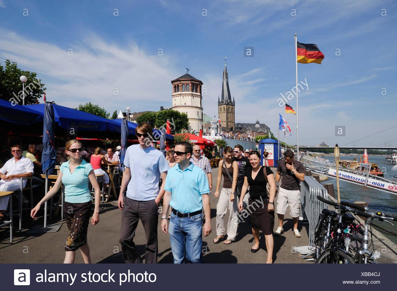 Young people on Duesseldorf's Rhine River waterside promenade, Duesseldorf, North Rhine-Westphalia, Germany, Europe - Stock Image