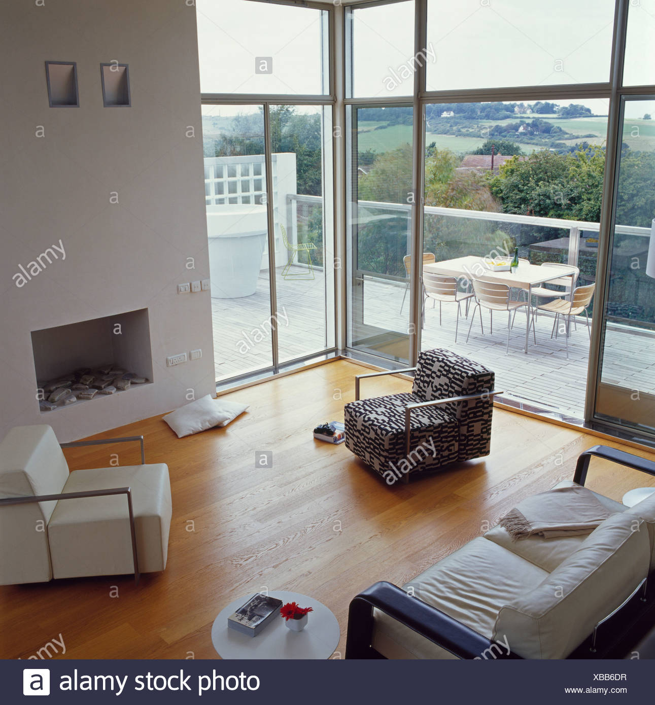Living Room With Fireplace And Sliding Doors: Large Modern Living Room With Glass Doors And Floor-to