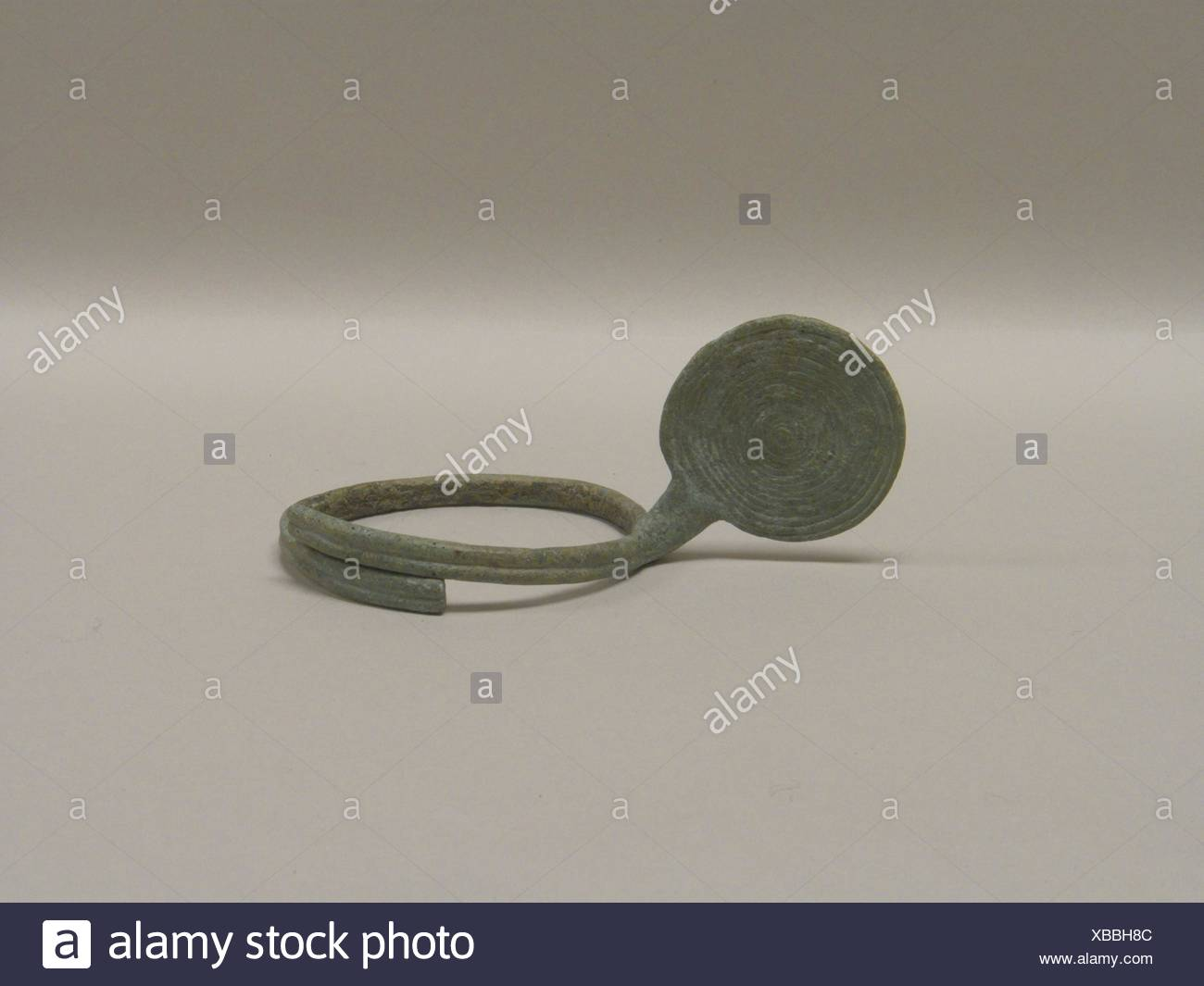 Anklet with Large Spiral Attachment. Period: Late period; Date: 300 B.C.-A.D. 400; Culture: Thailand; Medium: Bronze; Dimensions: H. 2 1/4 in. (5.7 - Stock Image