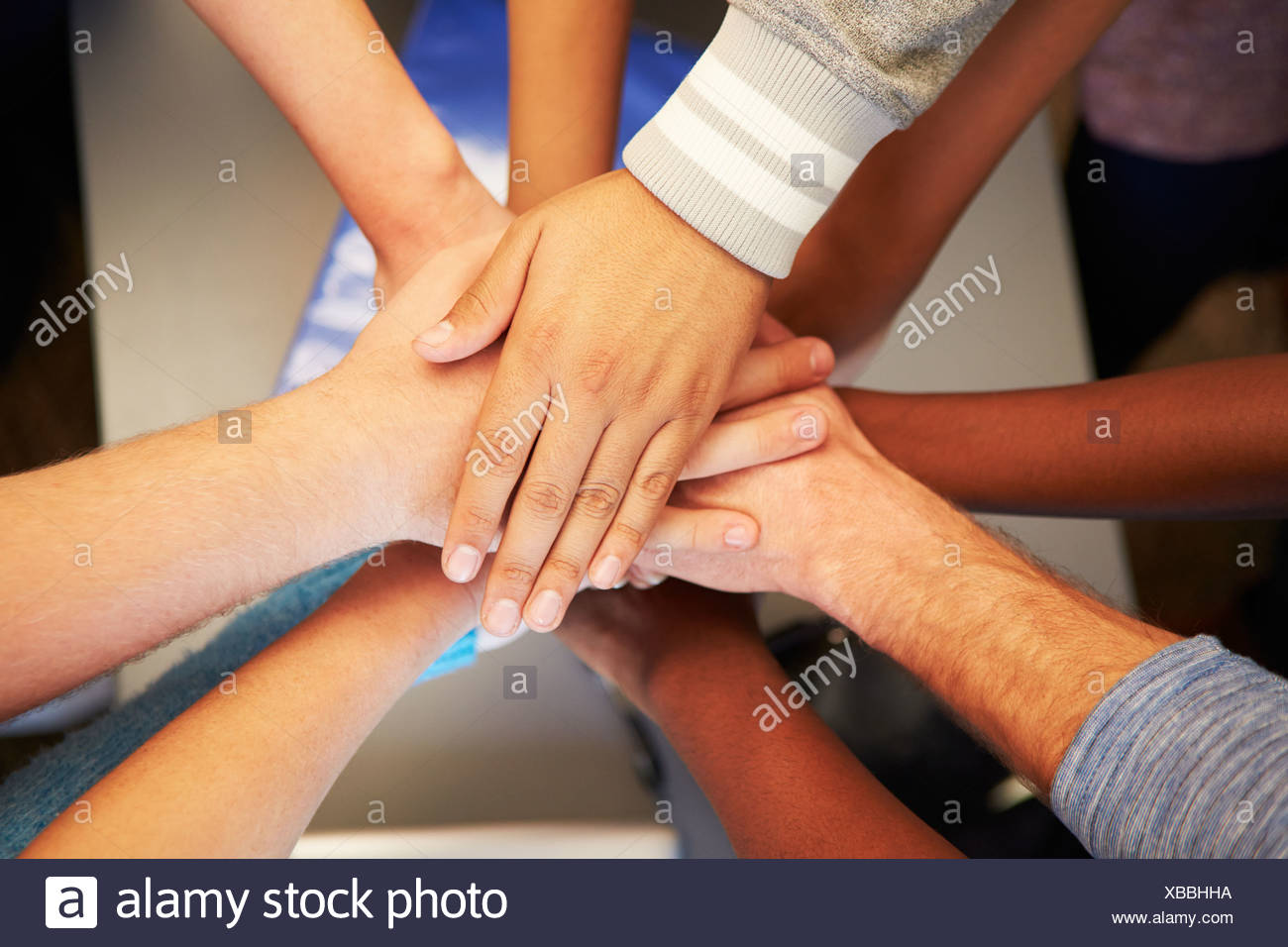 hands from young people of different races joined together stock