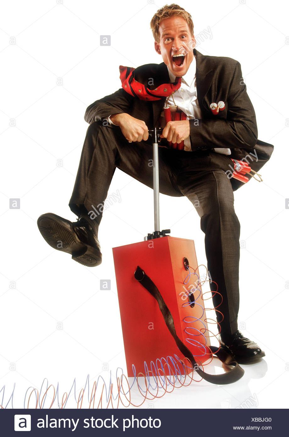 Businessman, dynamite, explosive charge, ignition mechanism, trigger, gesture concepts, businessman, spraying, sprinkle, release, ignition, breakdown, abnormal termination, release, destruction, power, lunacy, studio, copy space - Stock Image