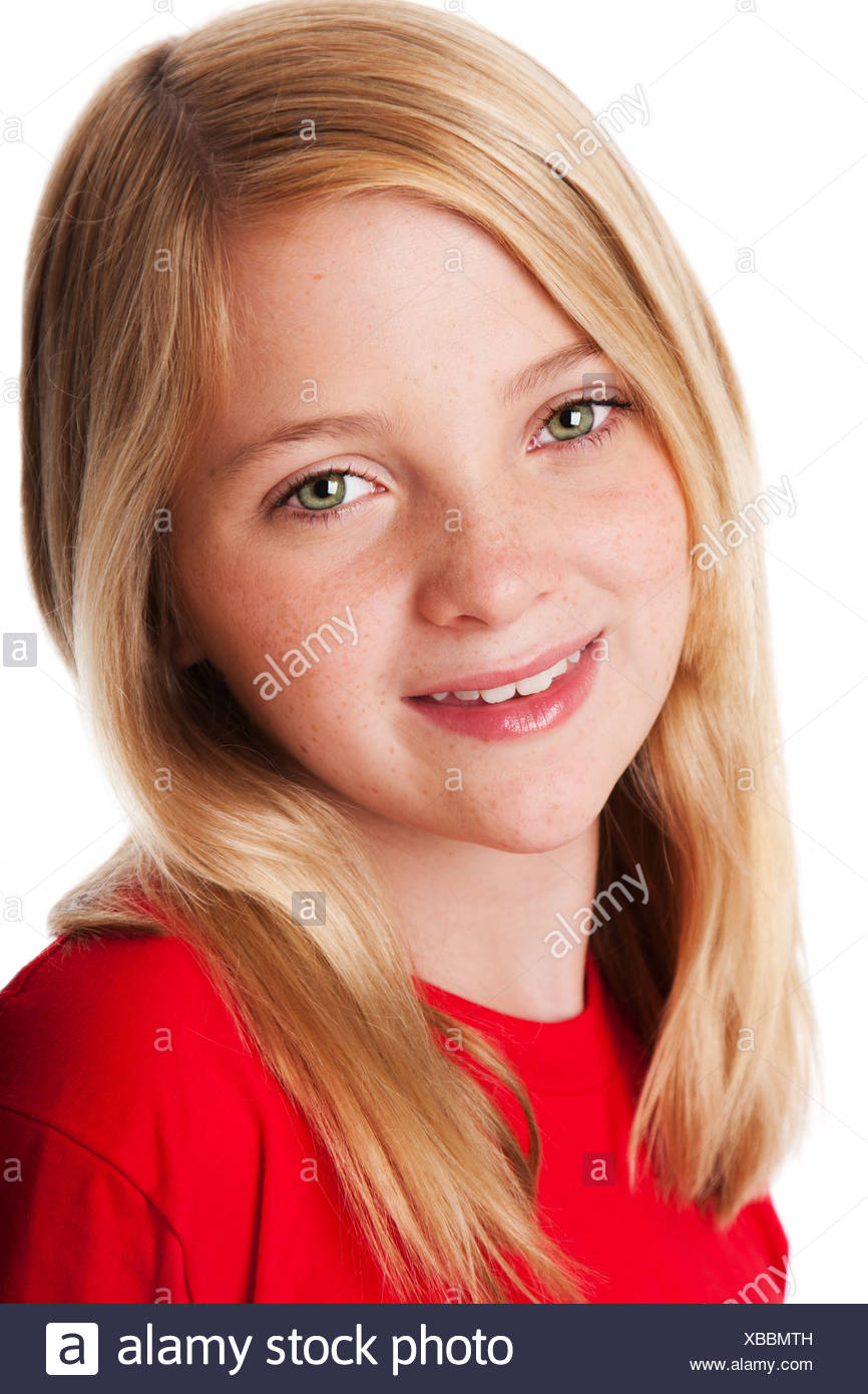 Beautiful face of a happy smiling teenager child girl with green eyes and blond hair, isolated. - Stock Image