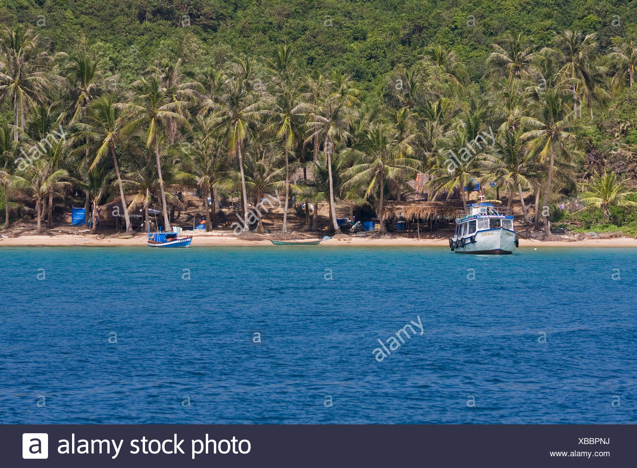 ambiance ambient beach dream dream-like heavenly holiday island like Long outdoor palm Phu Quoc sandy sea asia South-East - Stock Image