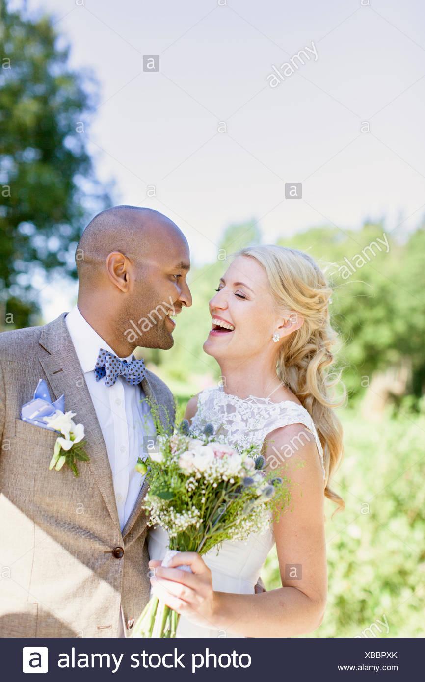 Sweden, Smaland, Mullsjo, Smiling newly wed couple - Stock Image