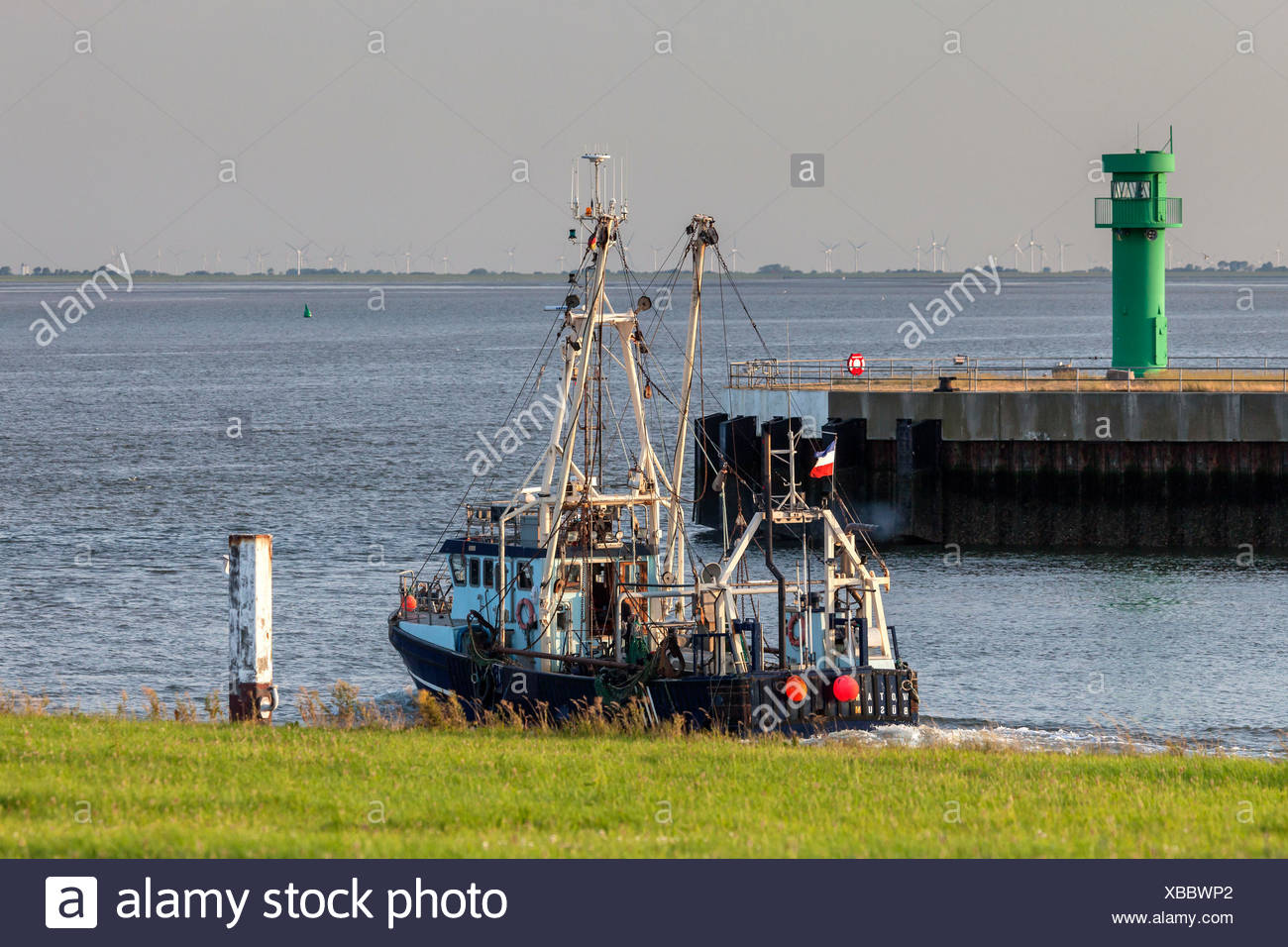 Crab cutters with the harbour exit, Büsum, Ditmarsh, Schleswig - Holstein, North Germany, Germany - Stock Image