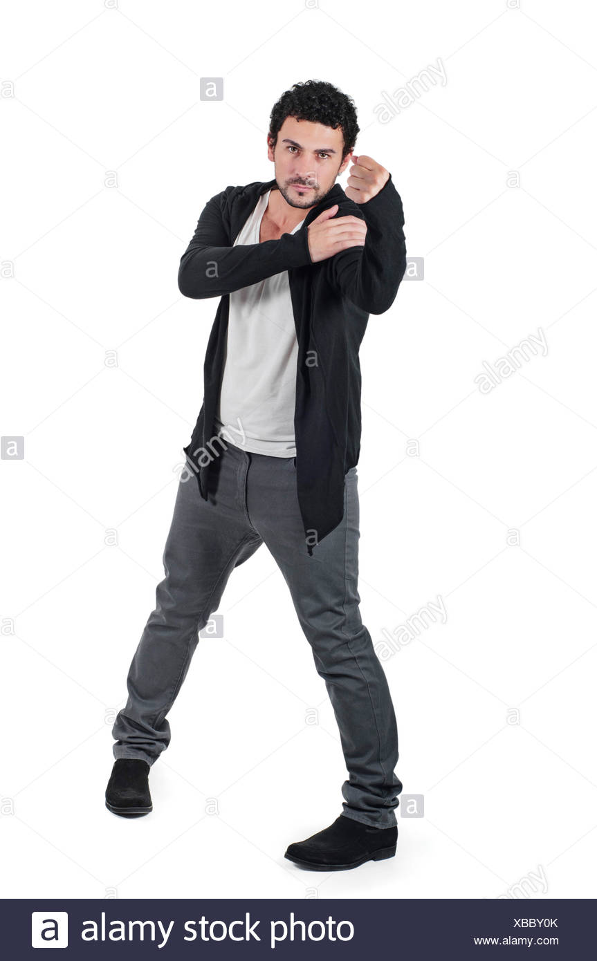 Angry man gesturing fist raised menacing threat - Stock Image