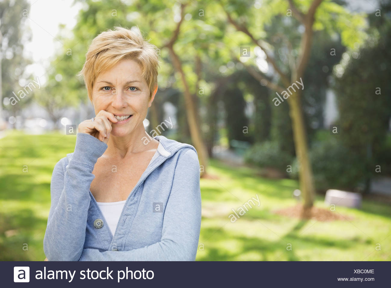 Portrait of woman standing outdoors - Stock Image