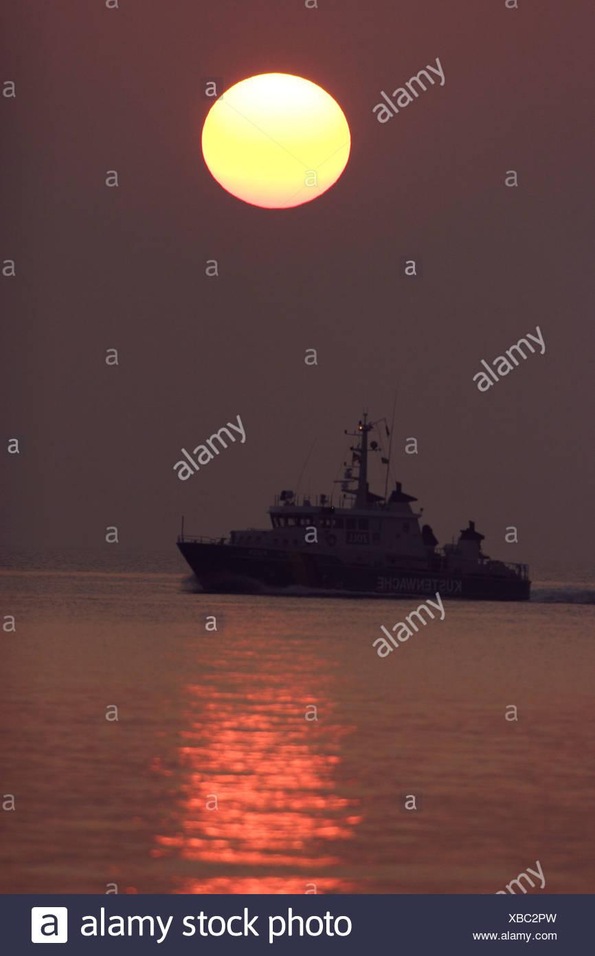 coast guard ship at dawn, Germany, Mecklenburg-Western Pomerania Stock Photo